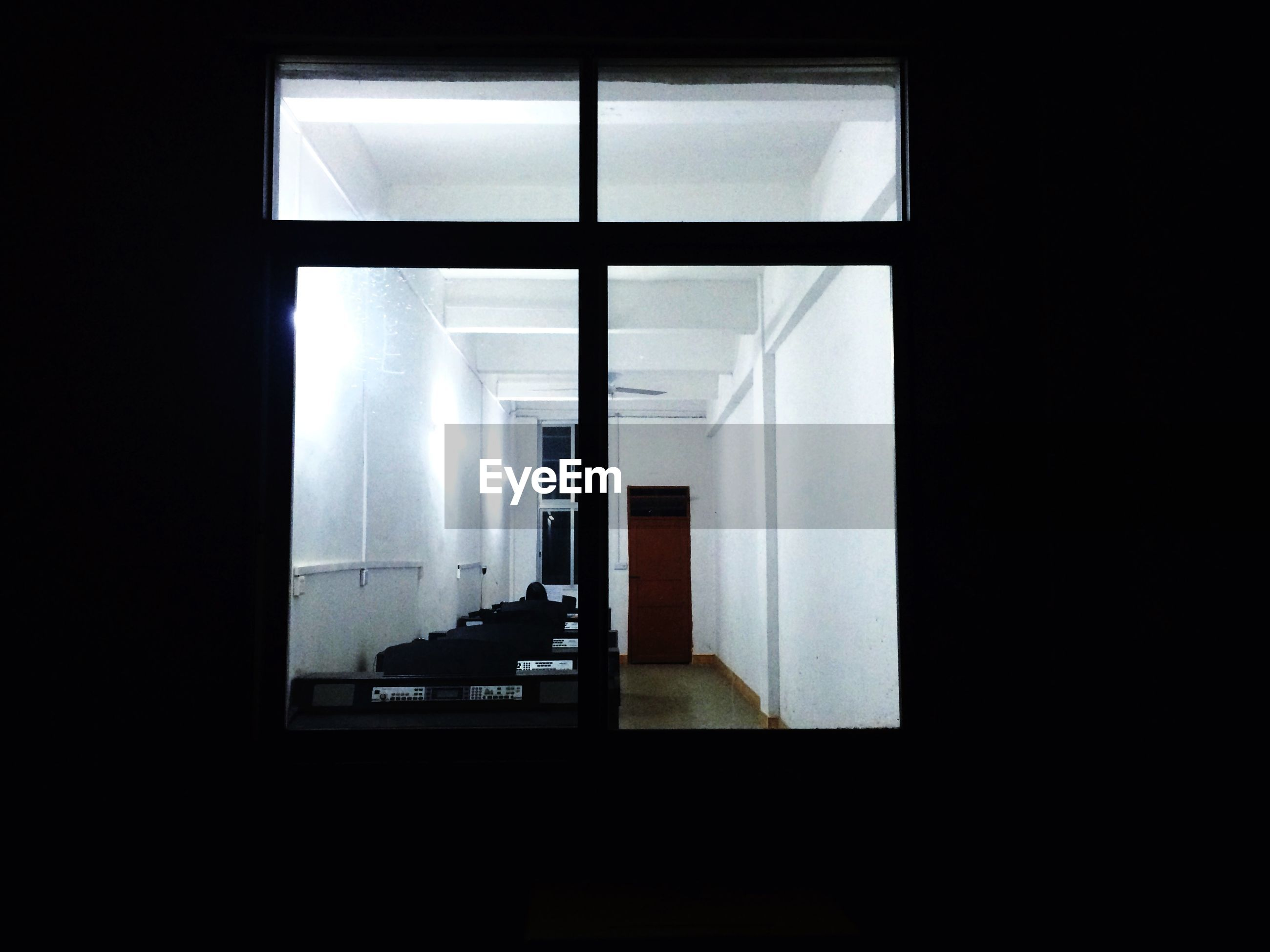 indoors, window, glass - material, architecture, built structure, transparent, home interior, reflection, dark, modern, curtain, absence, day, no people, sunlight, office, domestic room, house, copy space, silhouette