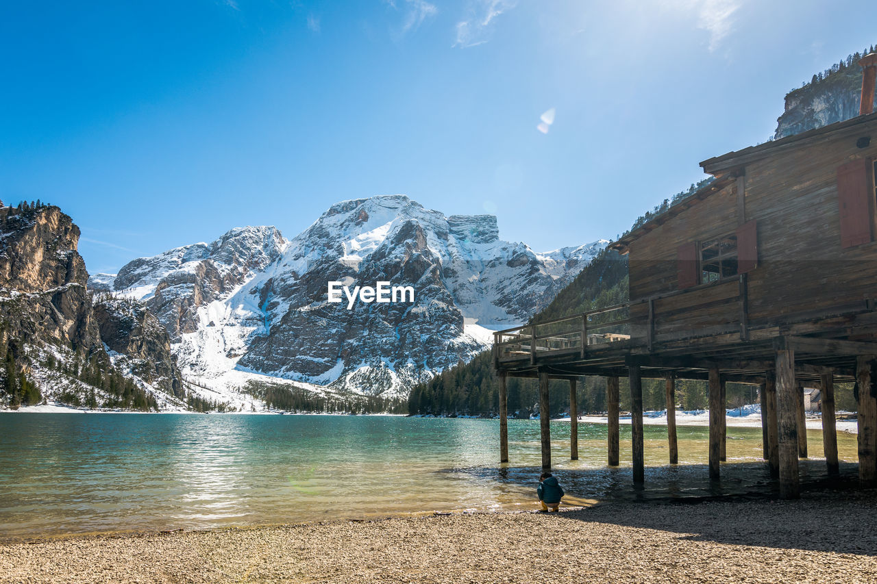 water, sky, architecture, mountain, built structure, beauty in nature, building exterior, nature, scenics - nature, day, cold temperature, winter, snow, sunlight, building, no people, tranquil scene, non-urban scene, outdoors, snowcapped mountain