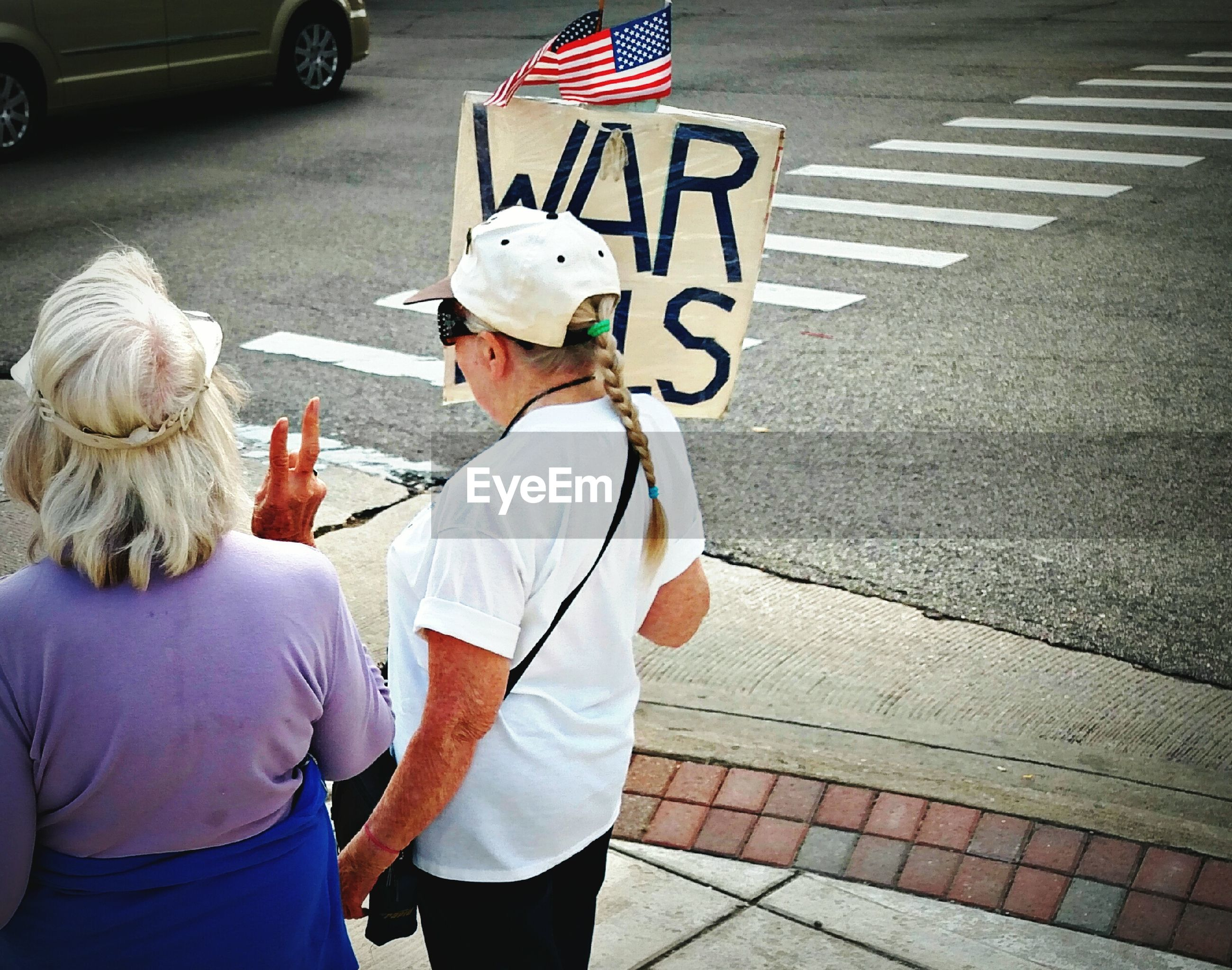 Senior women with american flags on street