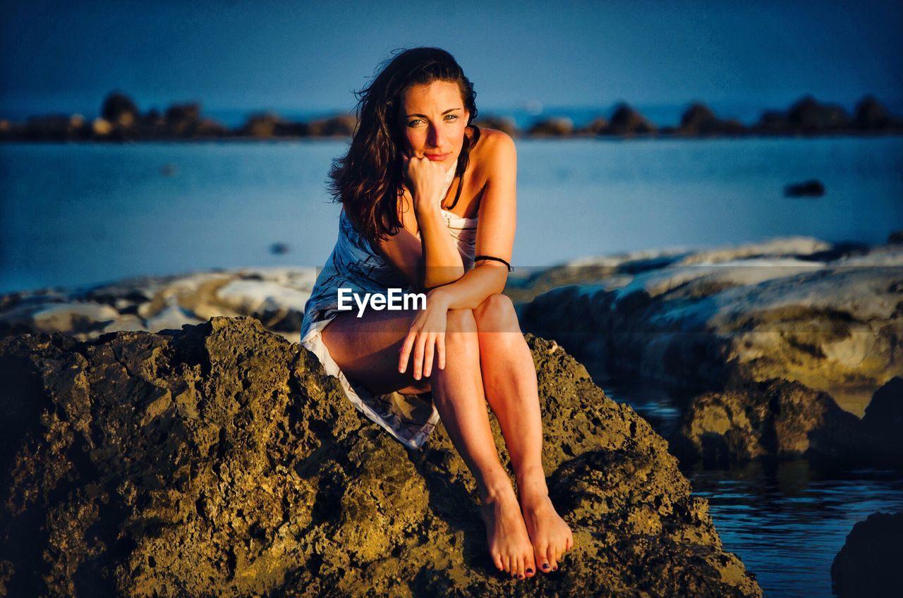 Beautiful young woman at seaside