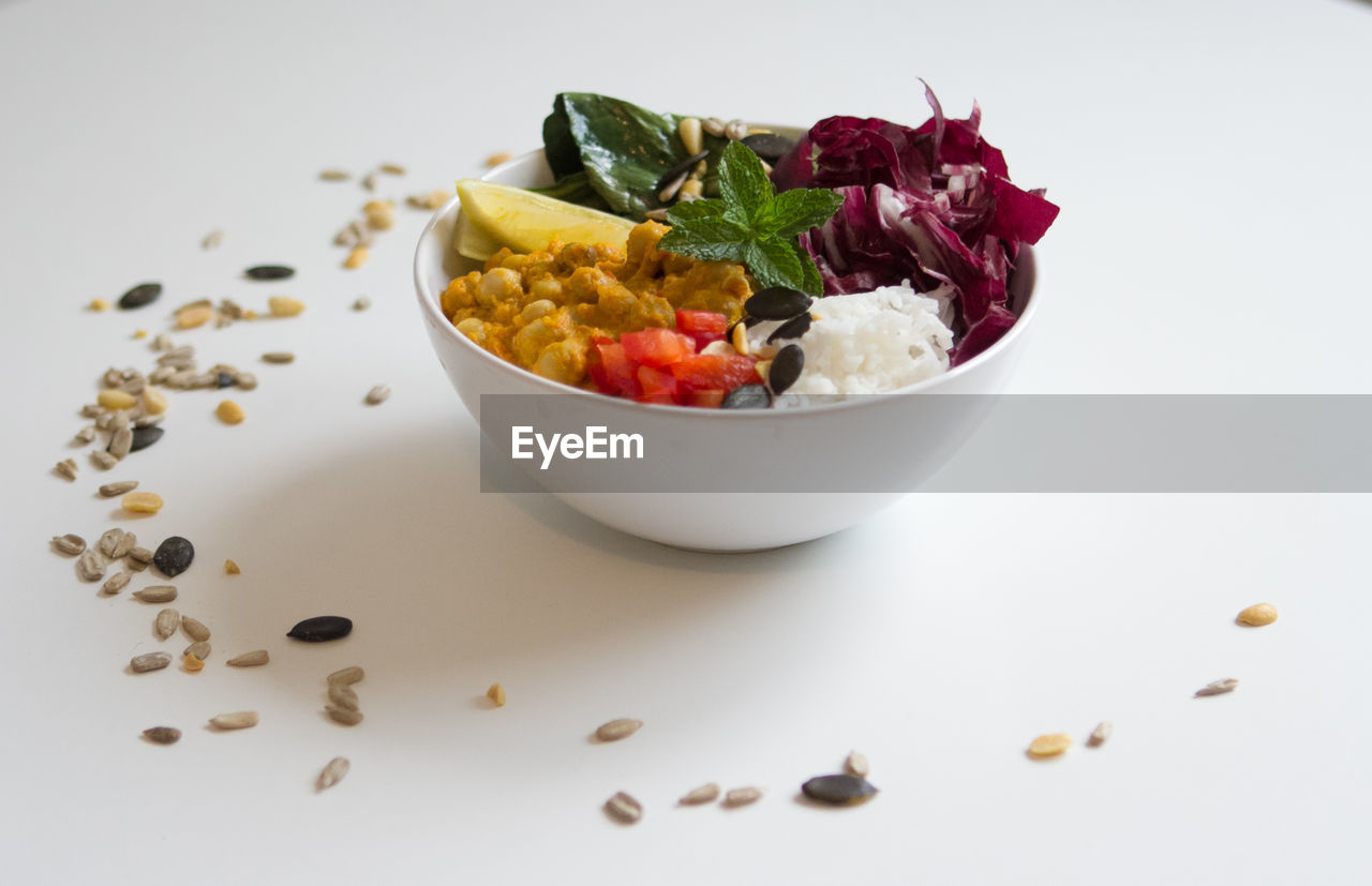 food, food and drink, bowl, freshness, healthy eating, wellbeing, indoors, still life, ready-to-eat, indulgence, vegetable, close-up, no people, studio shot, fruit, table, serving size, salad, white background, leaf, garnish, temptation