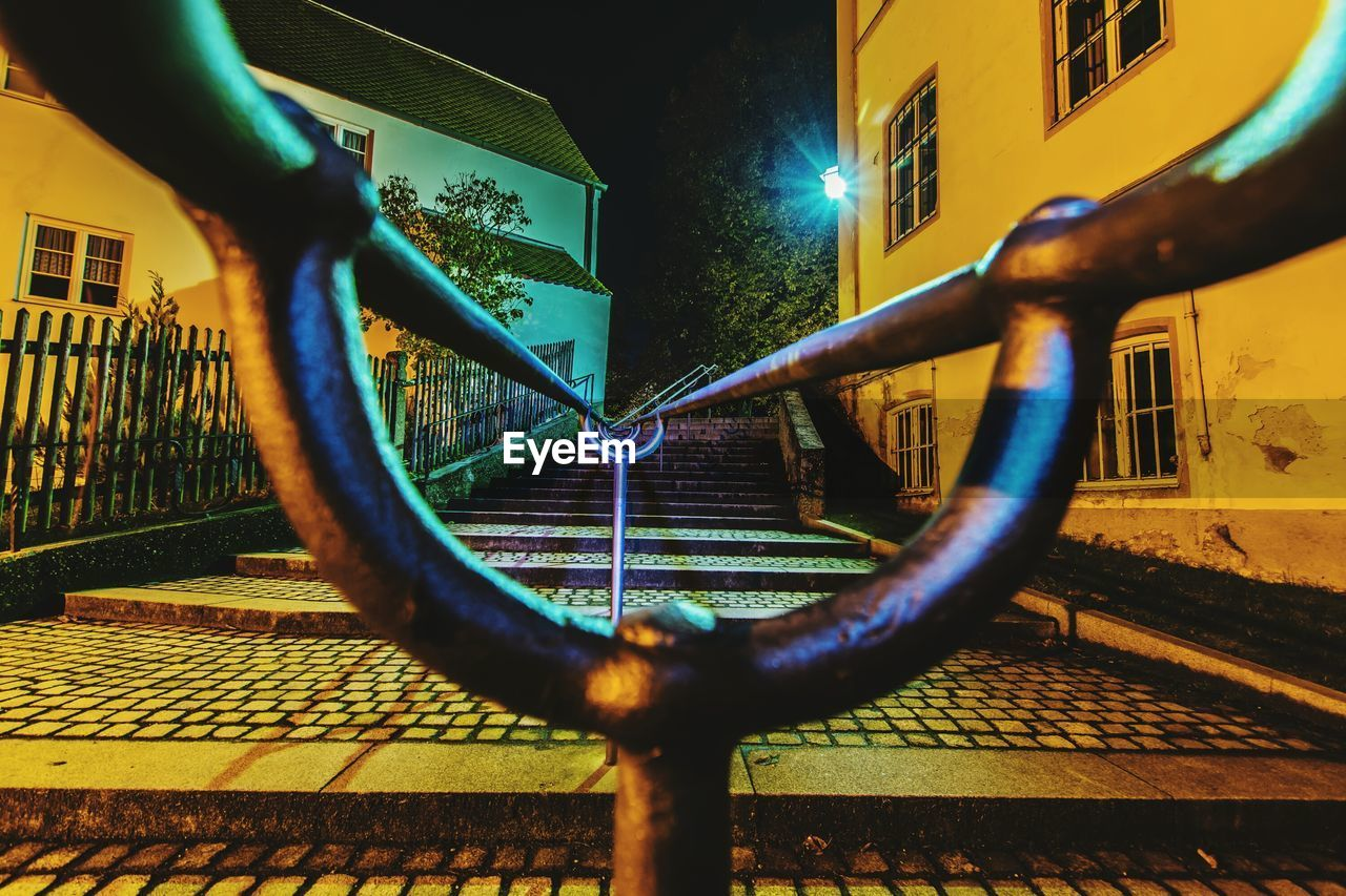 metal, railing, built structure, building exterior, architecture, outdoors, no people, city, close-up, day, illuminated