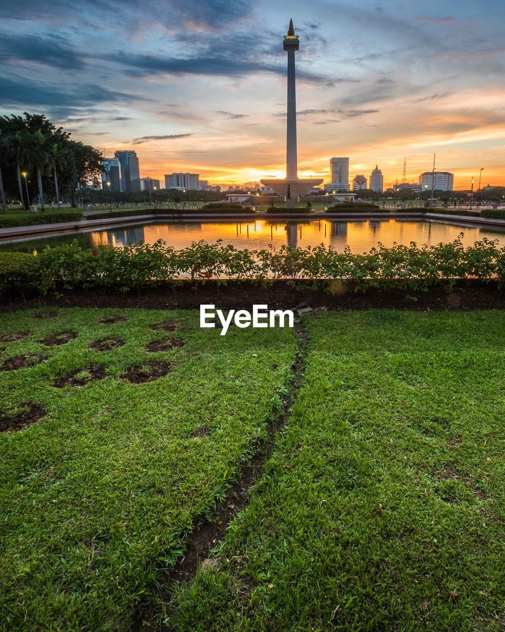 built structure, architecture, sunset, building exterior, water, sky, growth, no people, city, outdoors, nature, cloud - sky, grass, industry, fuel and power generation, skyscraper, factory, day