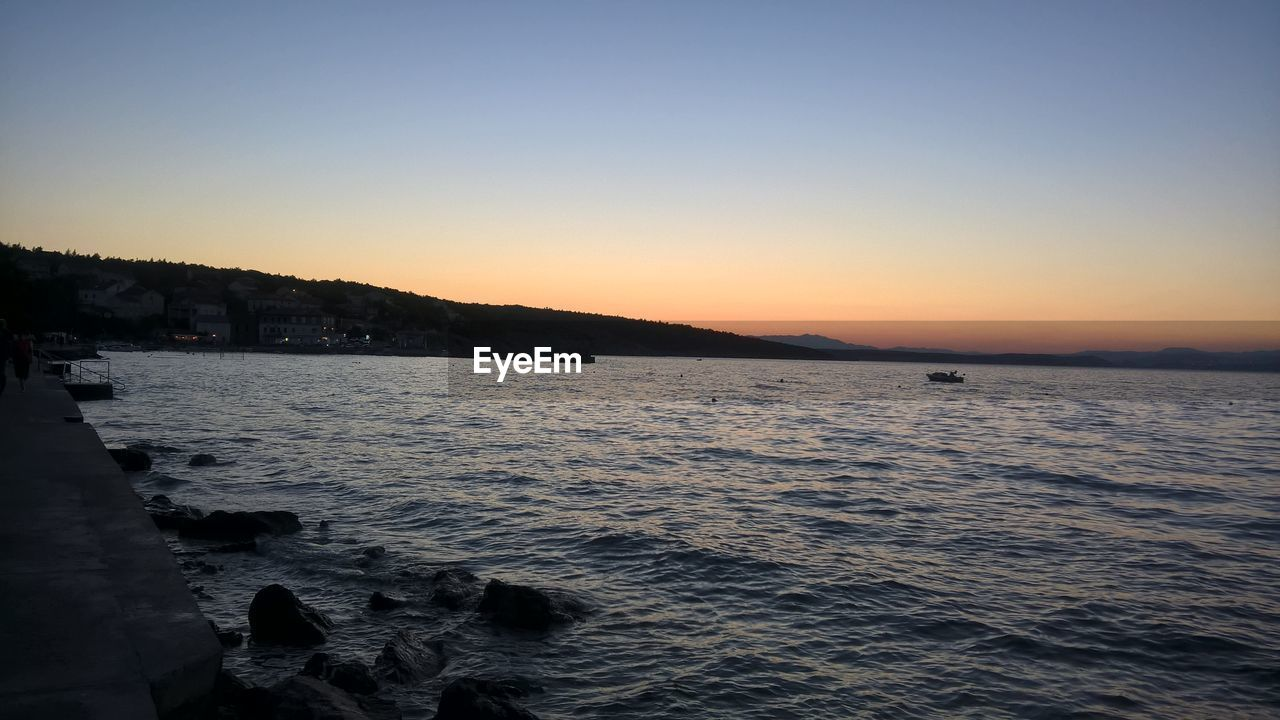 sunset, water, sea, nature, beauty in nature, scenics, clear sky, tranquil scene, tranquility, outdoors, no people, sky, architecture, day