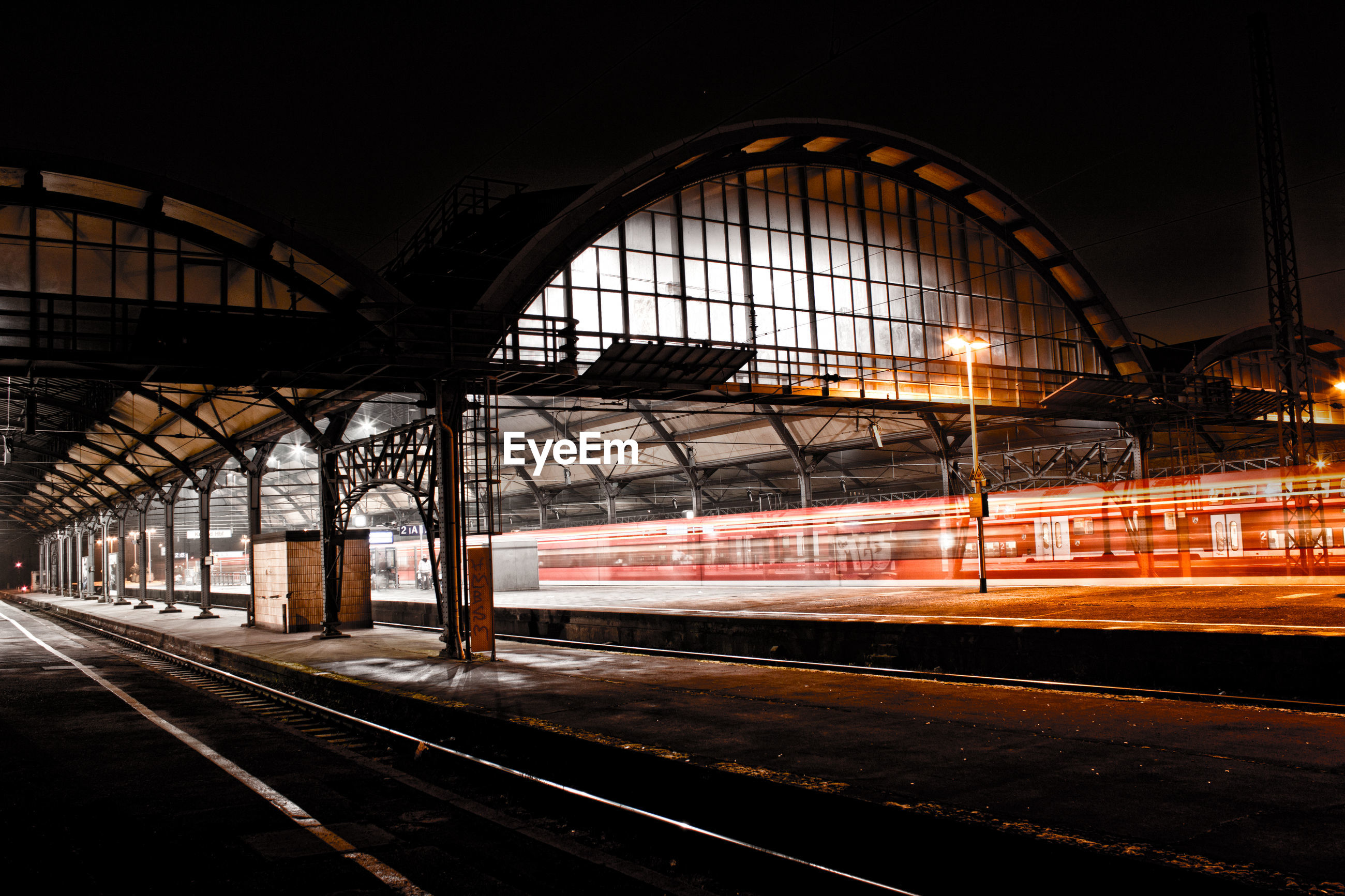 Blurred motion of train on railroad station at night