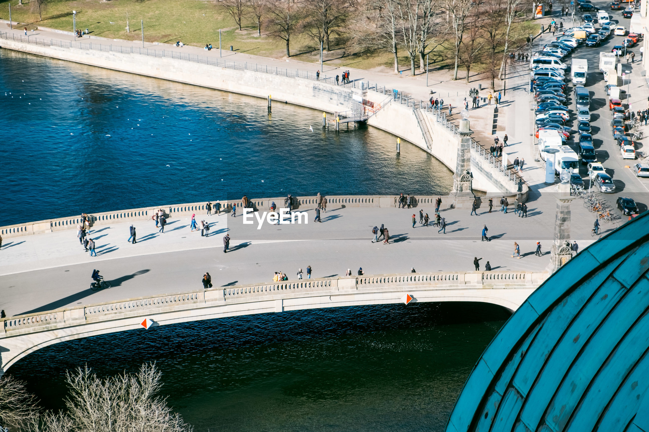 High angle view of people on bridge over river in city