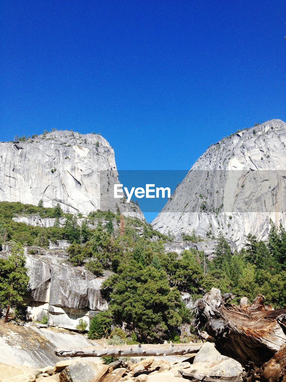 mountain, nature, clear sky, blue, rock - object, copy space, beauty in nature, scenics, no people, day, landscape, outdoors, high