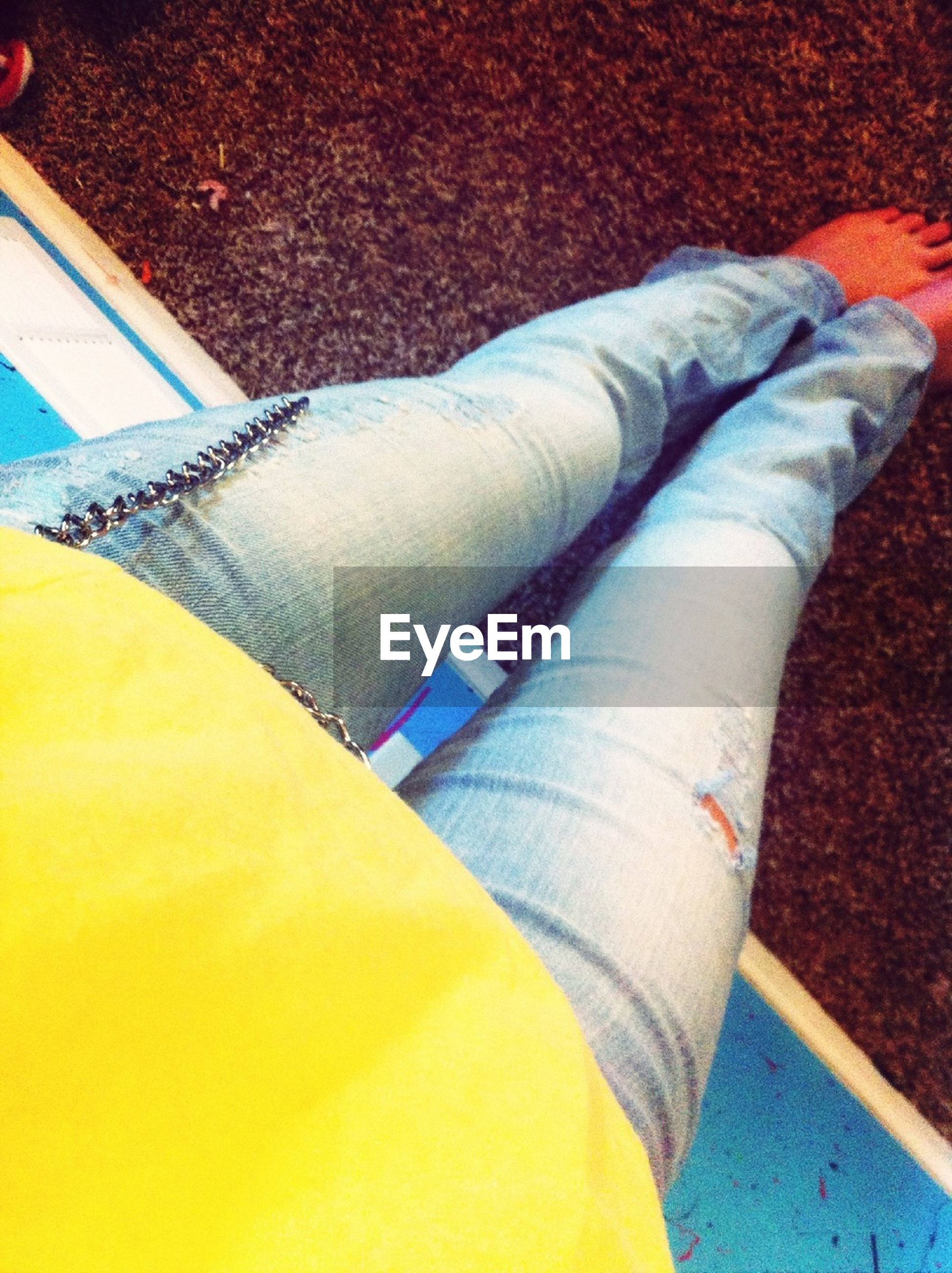 person, low section, personal perspective, part of, high angle view, close-up, multi colored, human foot, blue, fashion, shoe, lifestyles, yellow, indoors, textile, fabric