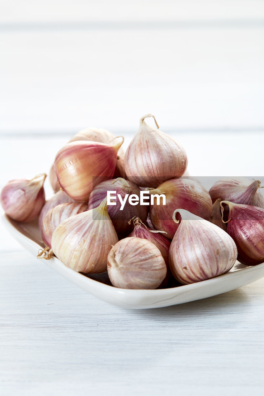Close-up of onions in plate on table
