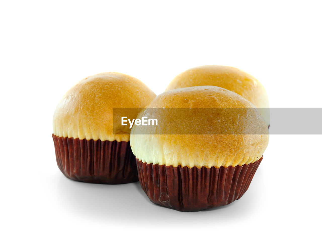 sweet food, cupcake, food and drink, studio shot, food, white background, dessert, indoors, cake, sweet, indulgence, close-up, still life, temptation, baked, freshness, no people, ready-to-eat, unhealthy eating, snack, cupcake holder, muffin