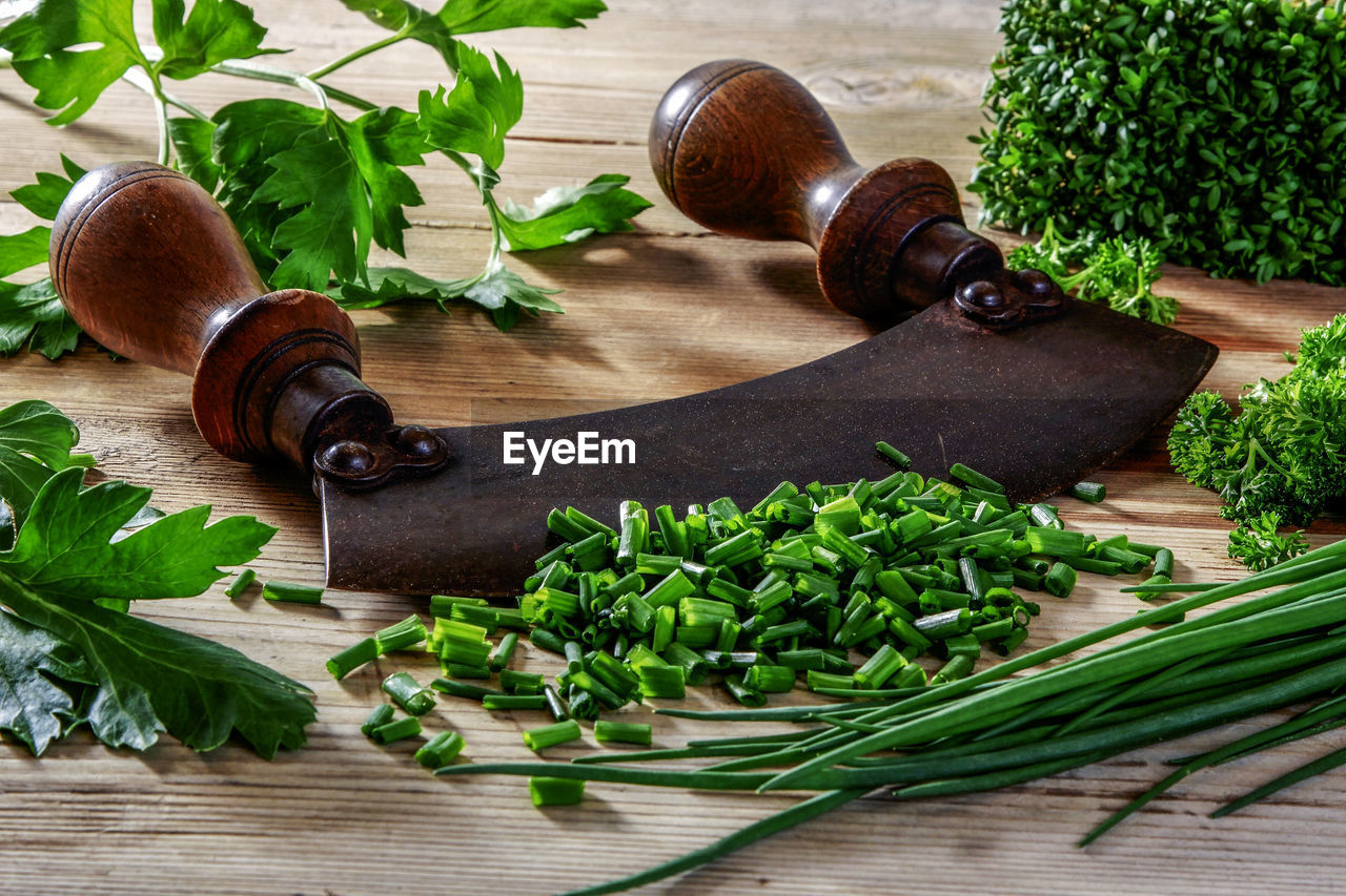 food and drink, food, healthy eating, freshness, vegetable, leaf, herb, plant part, no people, wellbeing, plant, indoors, table, green color, wood - material, still life, cutting board, ingredient, spice, cilantro, leaves