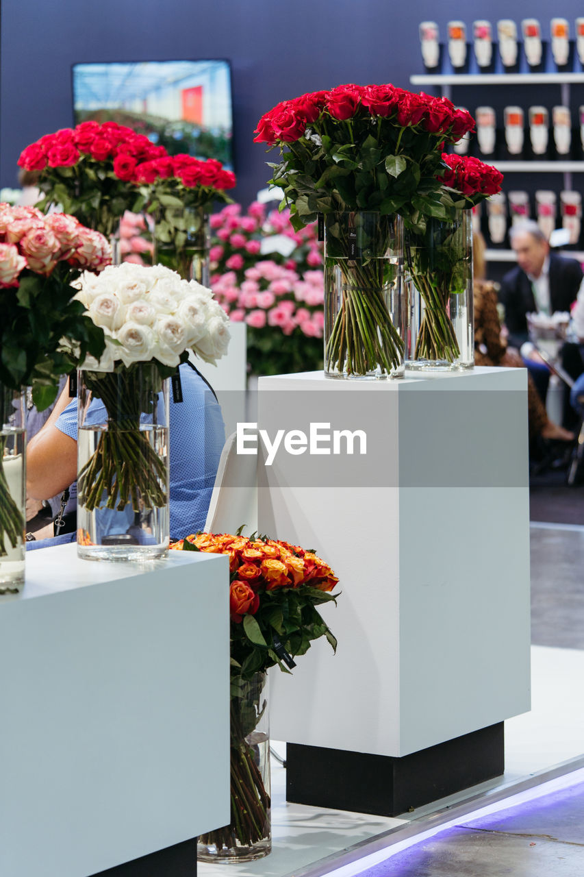 FLOWERS IN VASE AGAINST WALL