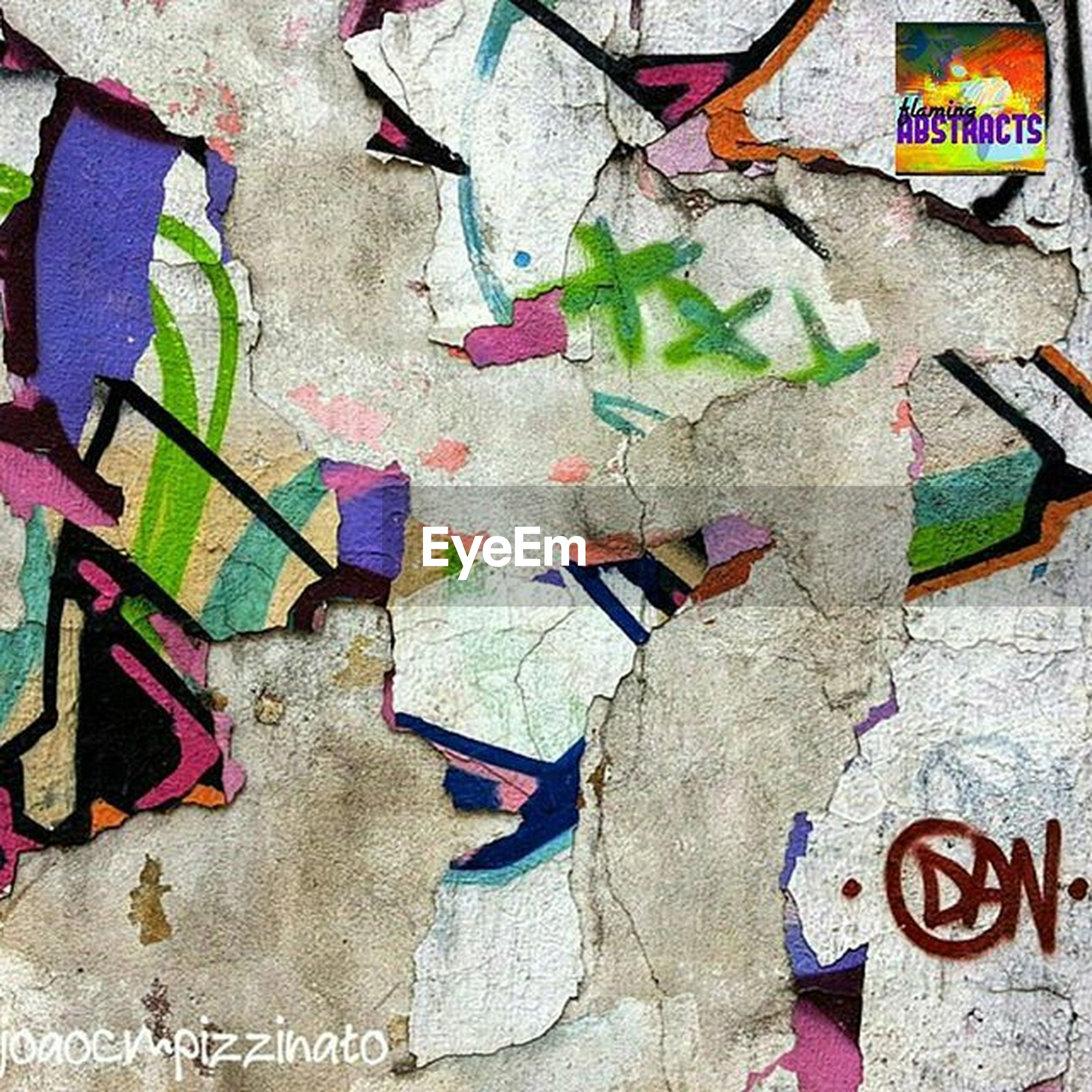 wall - building feature, creativity, graffiti, multi colored, art and craft, art, text, built structure, architecture, wall, textured, communication, close-up, western script, day, no people, street art, outdoors, paint, building exterior