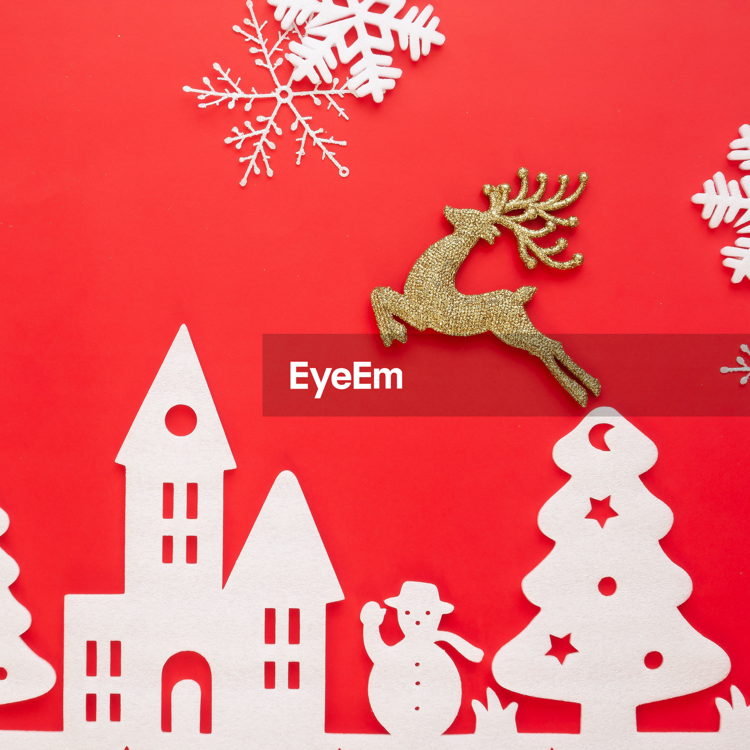 High angle view of christmas decoration against red background