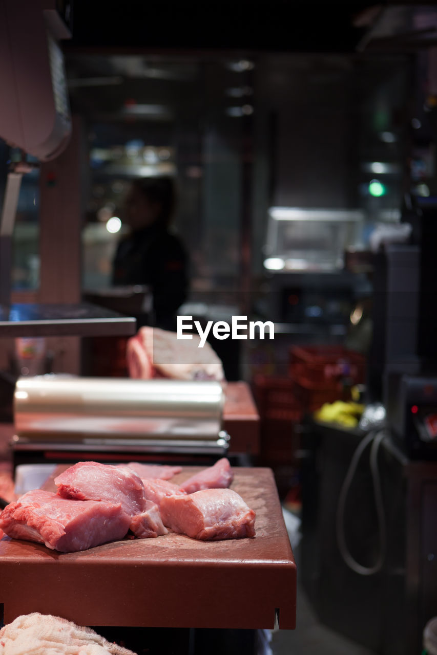 Close-Up Of Meat On Counter At Restaurant