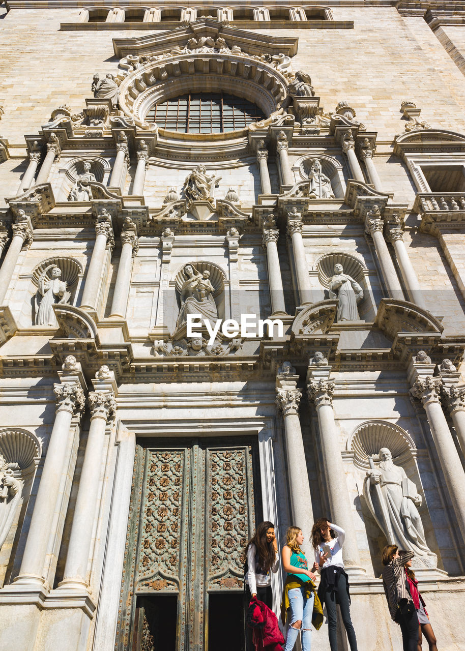 architecture, sculpture, built structure, statue, building exterior, representation, art and craft, human representation, the past, low angle view, history, building, day, travel destinations, real people, religion, place of worship, male likeness, creativity, architectural column, ornate