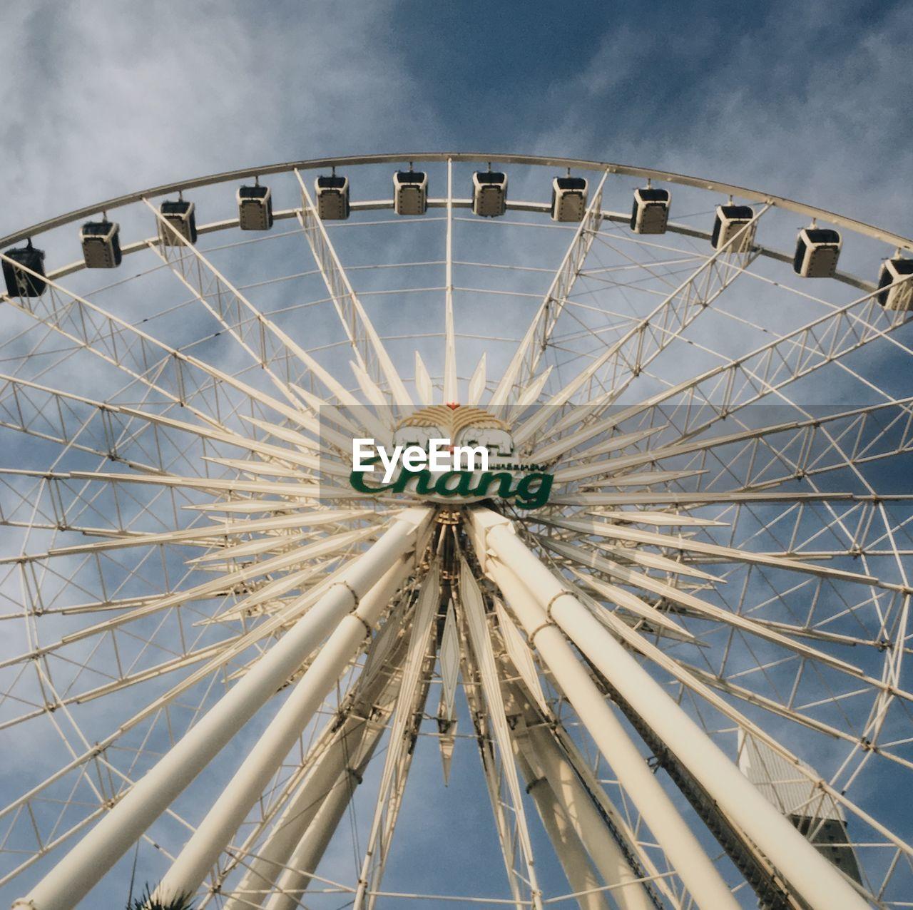 amusement park, arts culture and entertainment, amusement park ride, architecture, sky, ferris wheel, built structure, low angle view, metal, pattern, no people, day, circle, tourism, nature, geometric shape, shape, travel destinations, travel, outdoors, fairground, directly below