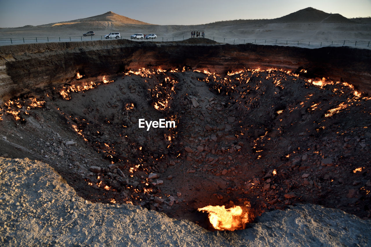 High Angle View Of Burnt Landscape Against Sky
