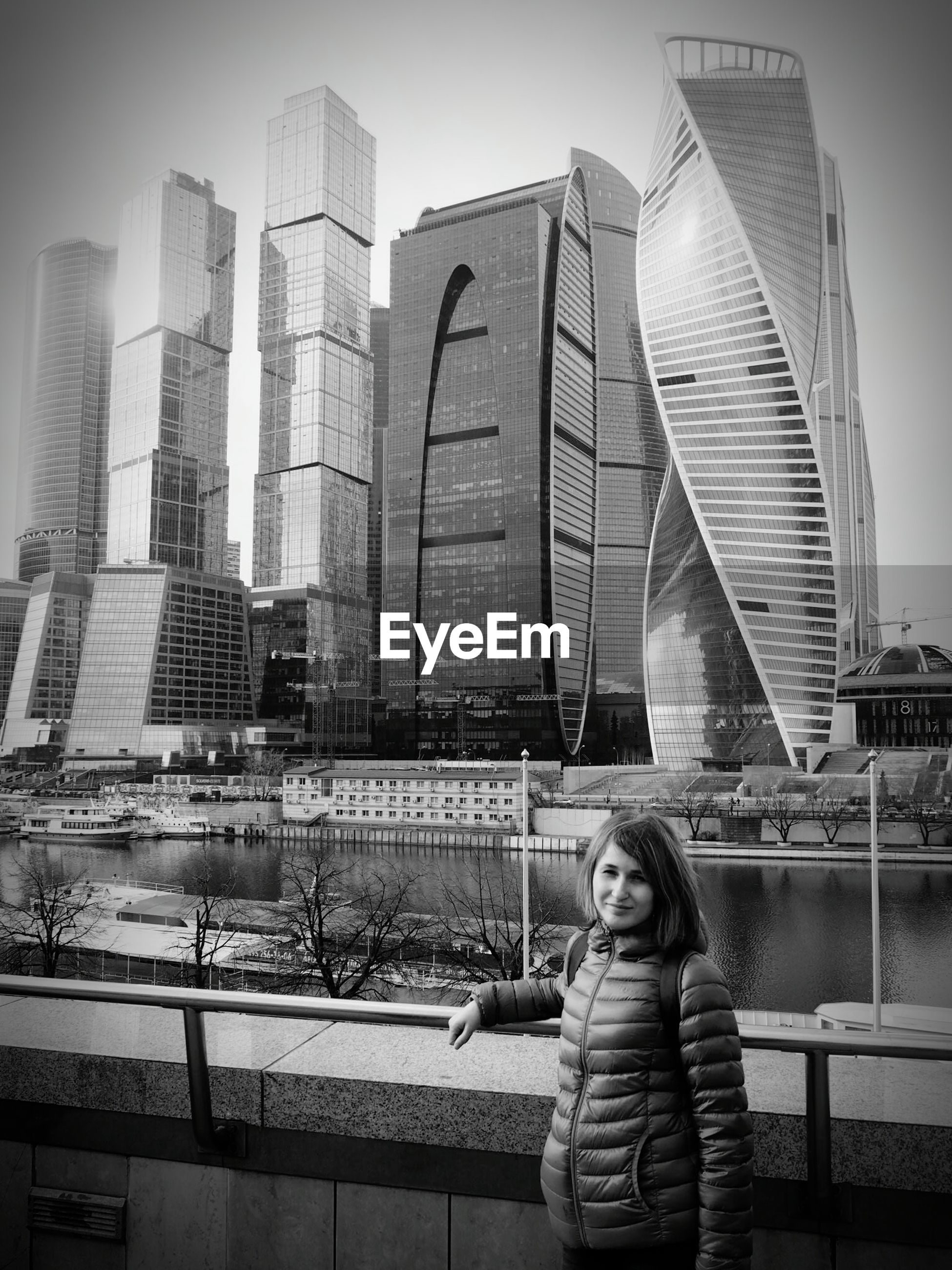 city, building exterior, travel destinations, skyscraper, architecture, one person, outdoors, urban skyline, real people, women, day, cityscape, leisure activity, one woman only, young adult, people, adults only, only women, adult, modern, one young woman only, downtown district
