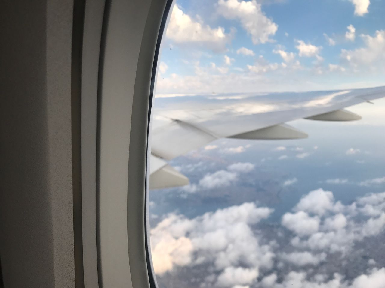 cloud - sky, journey, transportation, airplane, vehicle interior, sky, mode of transport, window, travel, air vehicle, aerial view, beauty in nature, nature, cloudscape, scenics, airplane wing, day, no people, tranquil scene, public transportation, flying, landscape, close-up, outdoors