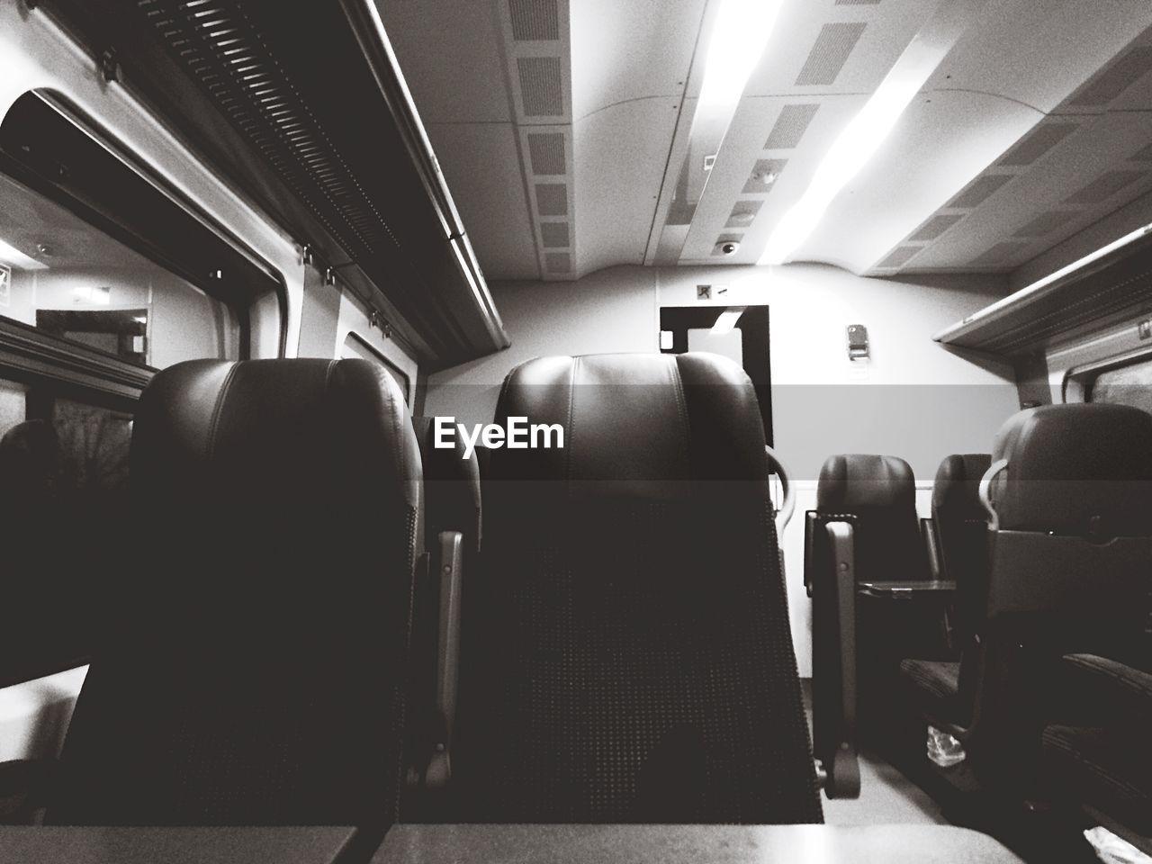 vehicle interior, indoors, vehicle seat, transportation, illuminated, travel, seat, public transportation, journey, sitting, subway train, real people, day