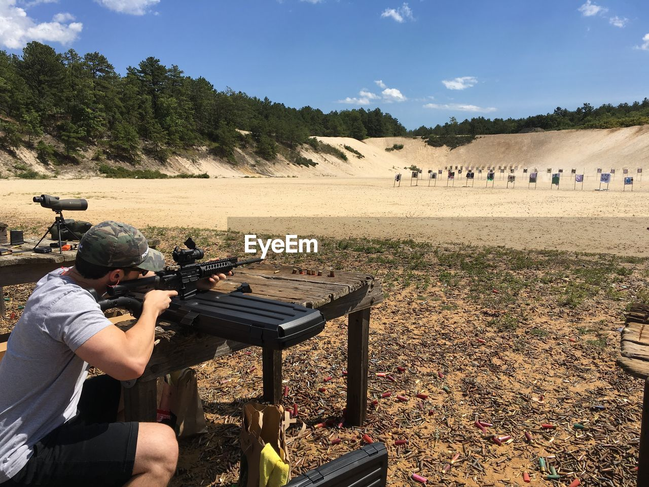Man Practicing With Rifle At Shooting Range