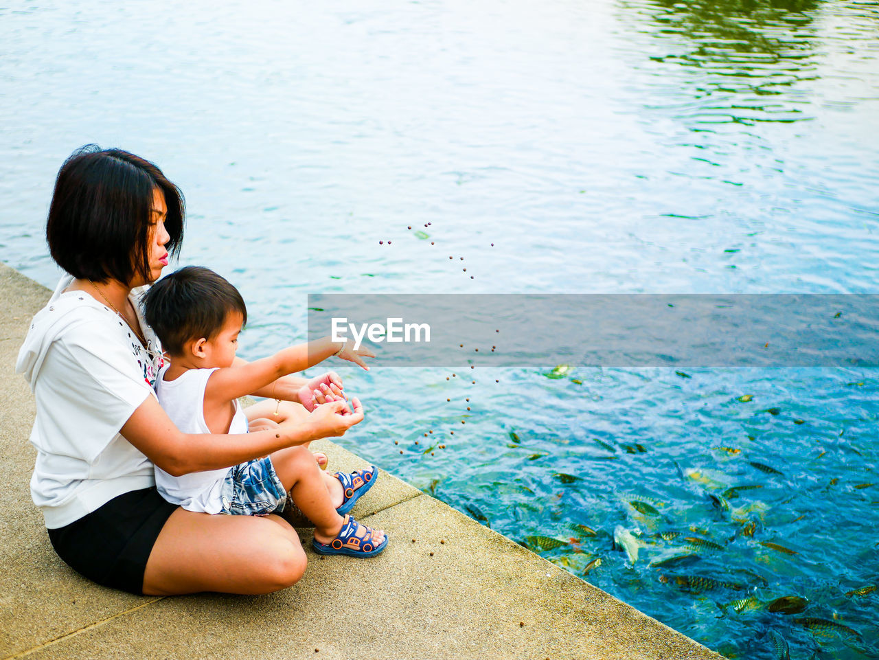 child, water, childhood, real people, family, leisure activity, females, lifestyles, males, women, two people, togetherness, boys, full length, day, casual clothing, men, innocence, outdoors, sister, positive emotion