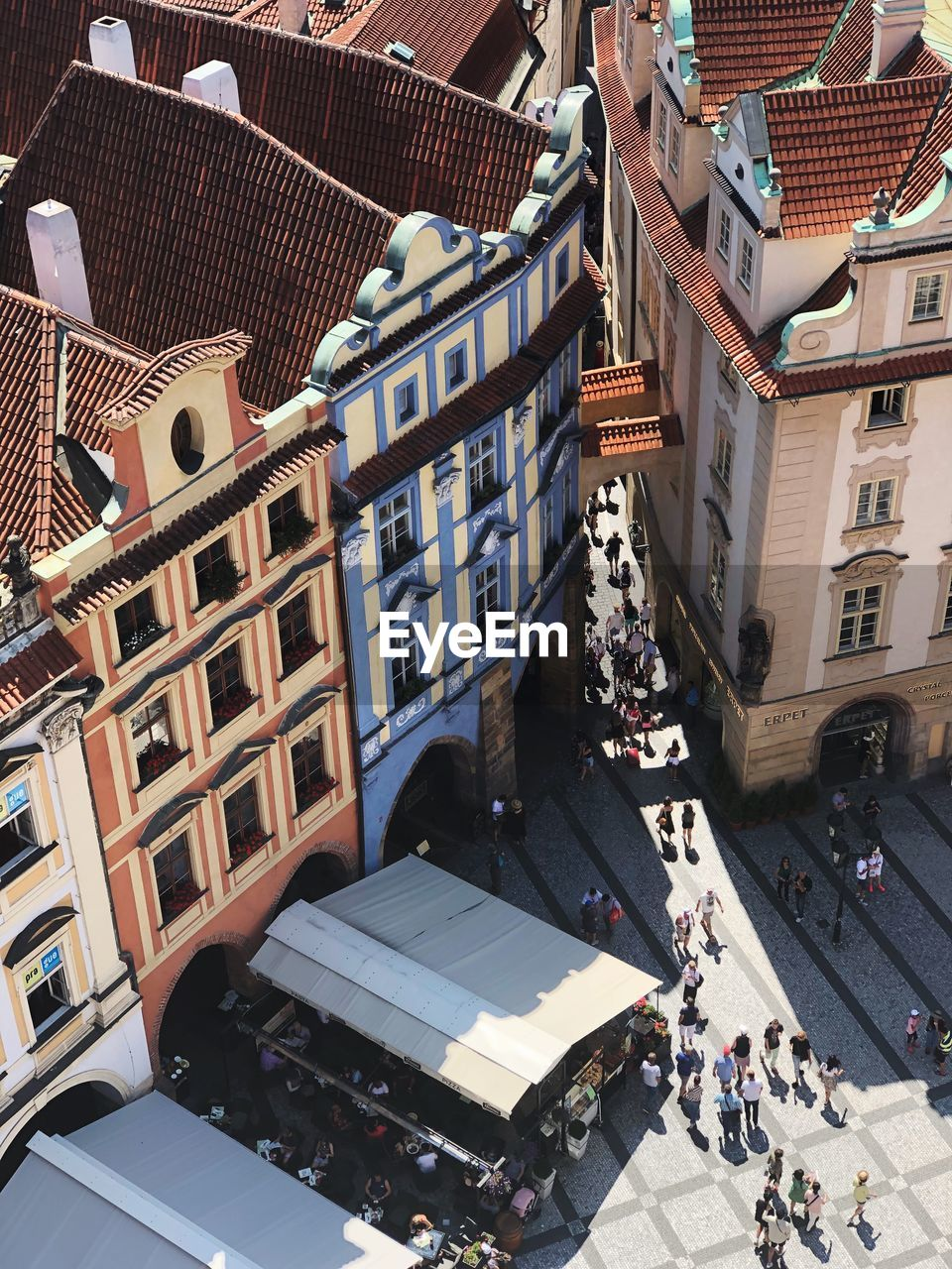 High Angle View Of Street By Buildings In City During Sunny Day