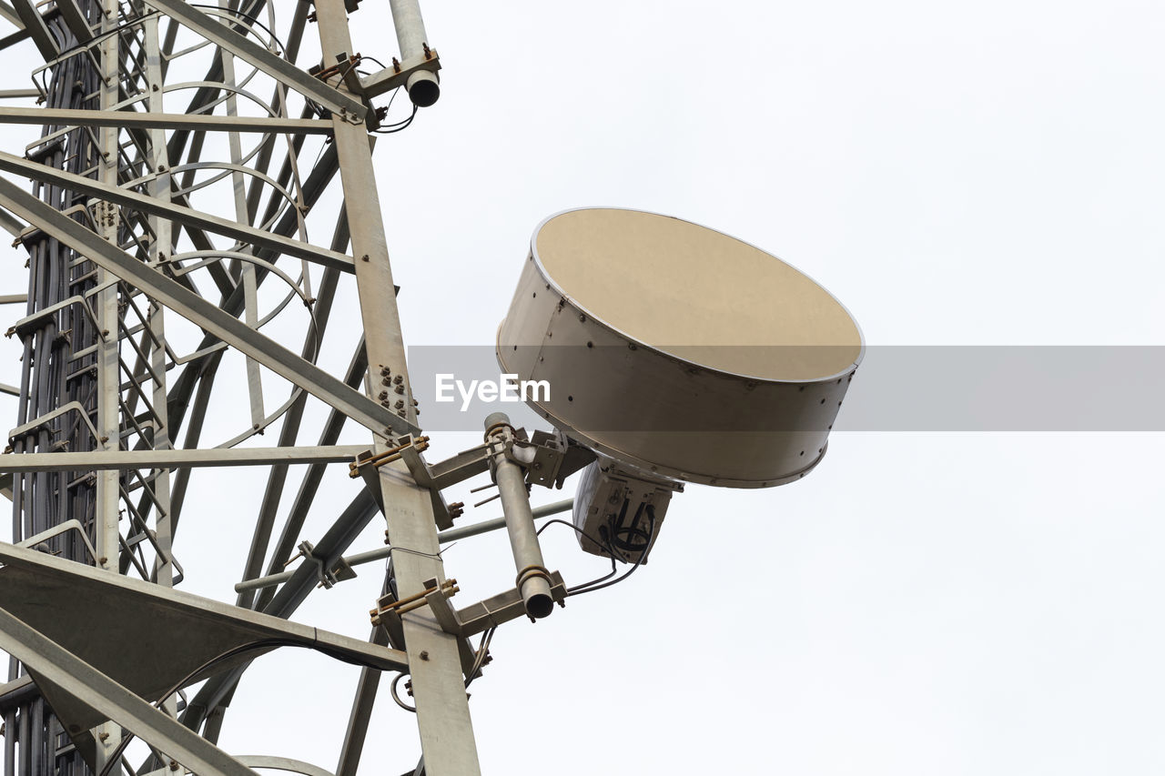 low angle view, metal, no people, sky, copy space, clear sky, technology, communication, arts culture and entertainment, white background, day, connection, equipment, nature, close-up, built structure, architecture, outdoors, cut out, music