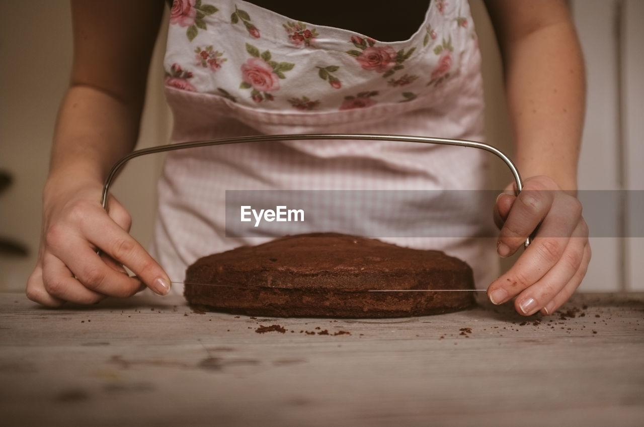 Woman cutting cake in half