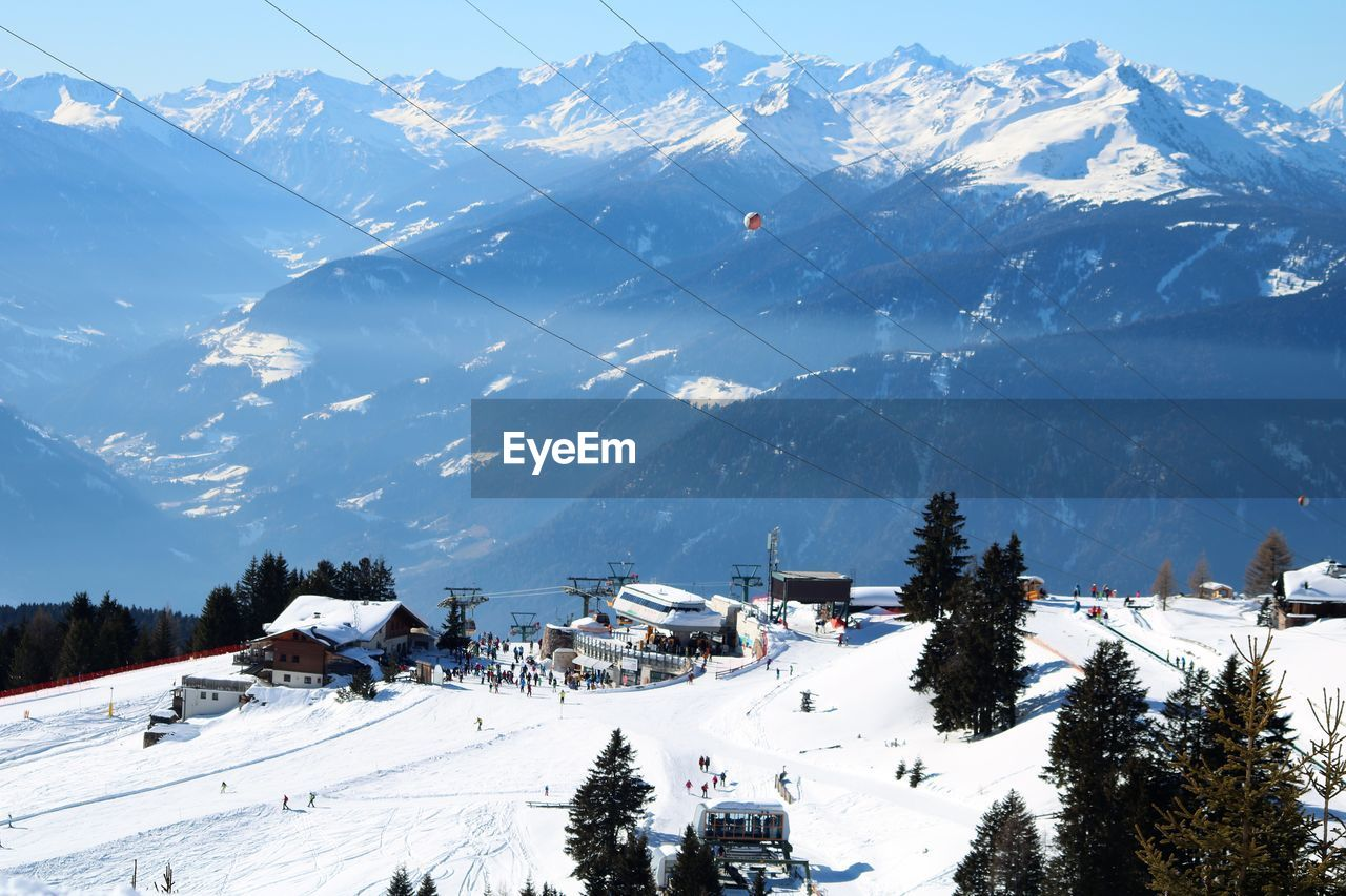 mountain, snow, winter, skiing, nature, landscape, beauty in nature, cold temperature, scenics, sky, outdoors, mountain range, tranquility, tranquil scene, range, snowcapped mountain, adventure, ski holiday, overhead cable car, holiday, ski lift, day, no people