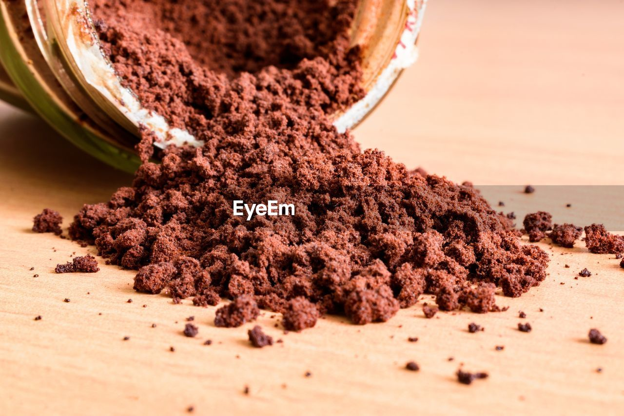 food and drink, selective focus, food, close-up, indoors, still life, brown, ground - culinary, freshness, table, no people, spice, ground coffee, healthy eating, ingredient, container, wellbeing, preparation, spilling, coffee - drink, caffeine