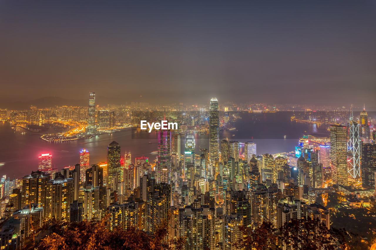 building exterior, city, architecture, cityscape, built structure, illuminated, building, sky, office building exterior, night, crowded, skyscraper, tall - high, crowd, urban skyline, modern, nature, residential district, high angle view, outdoors, financial district, spire