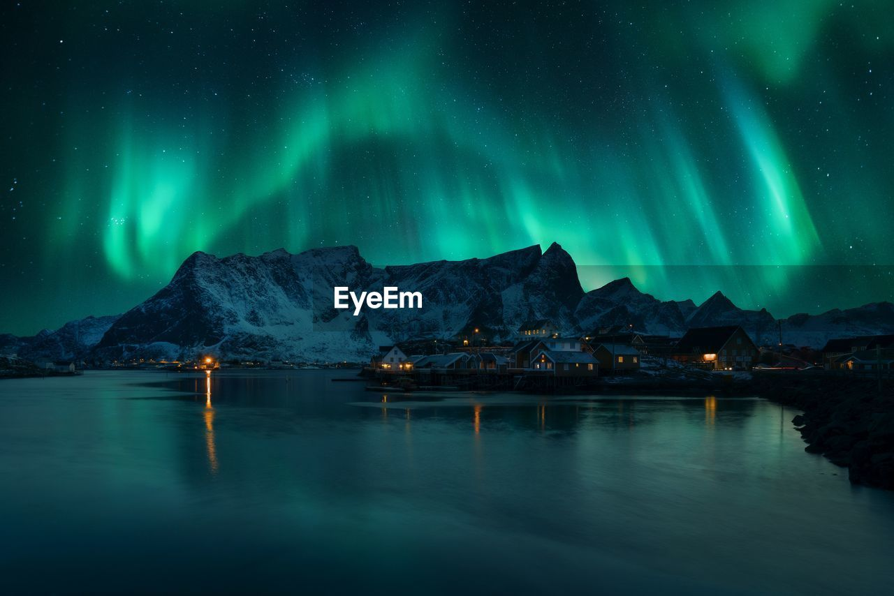 Scenic View Of Aurora Borealis Over Snowcapped Mountain