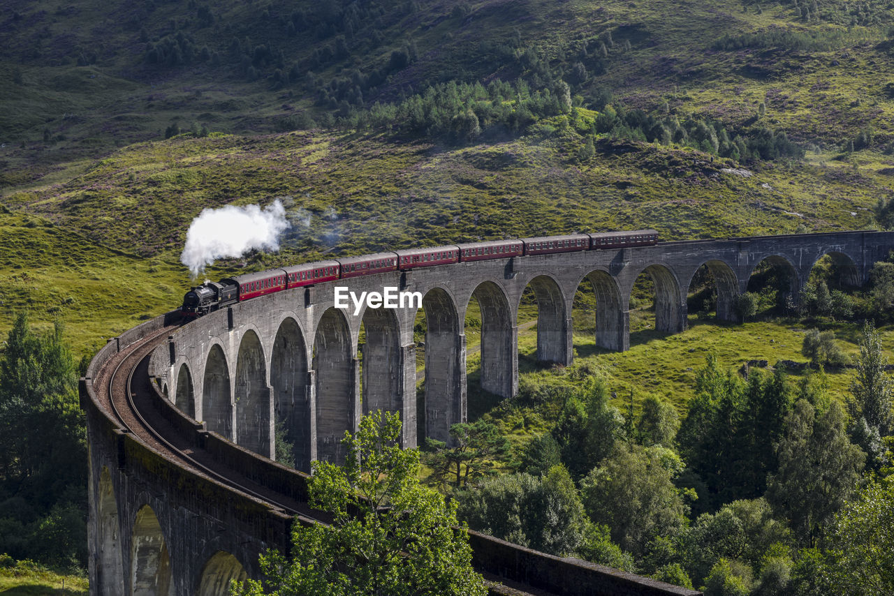 View Of Steam Train On Bridge