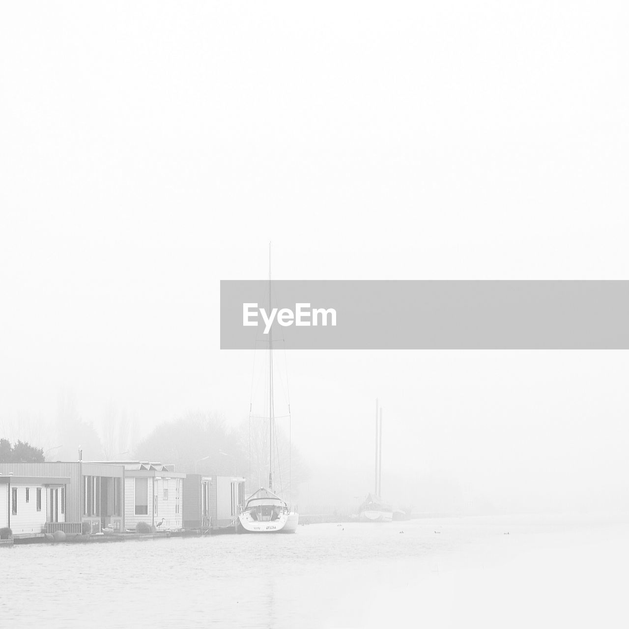 copy space, fog, no people, outdoors, transportation, day, winter, built structure, architecture, nautical vessel, building exterior, cold temperature, nature, mast, sky