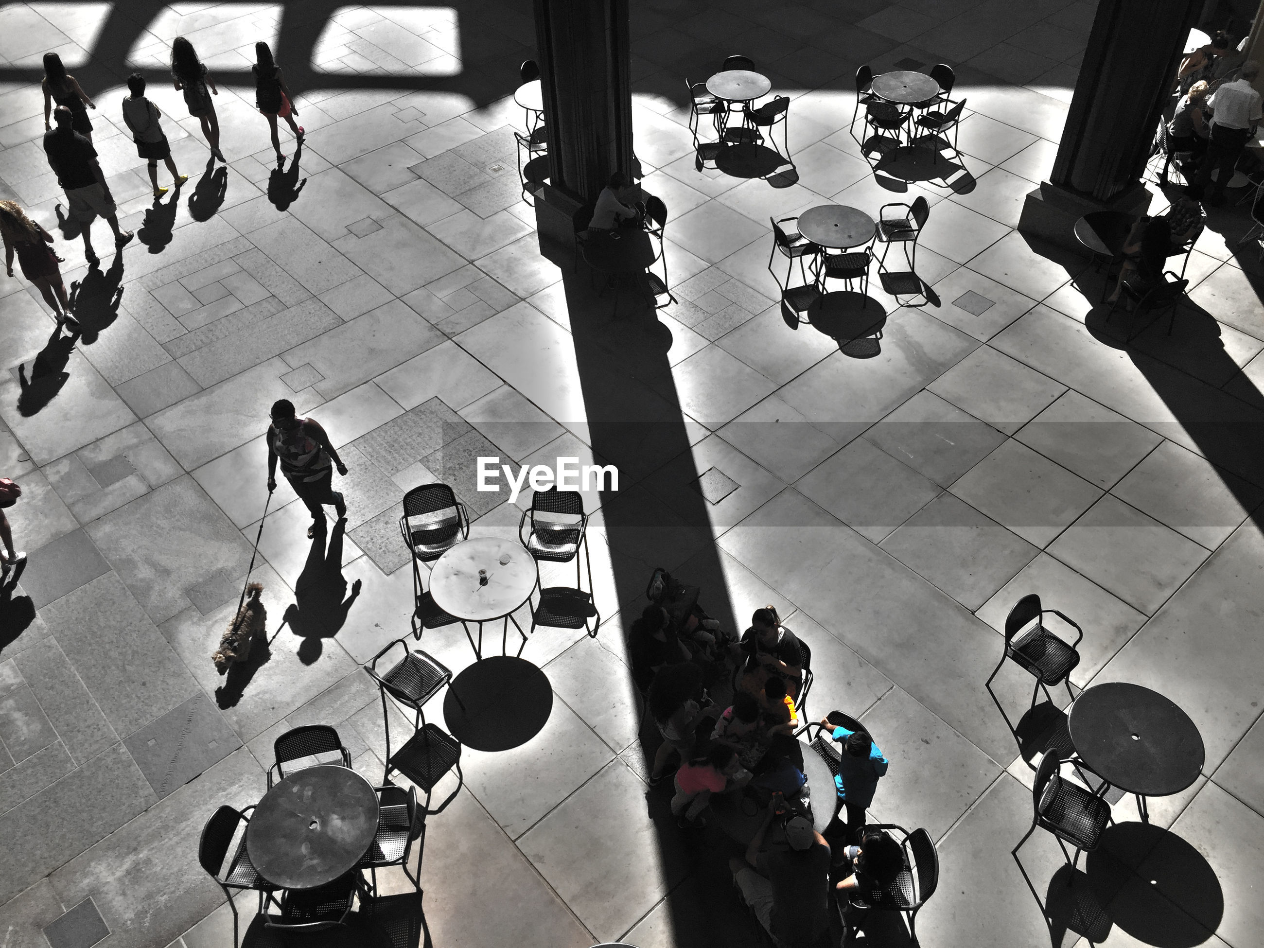 High angle view of people sitting on floor