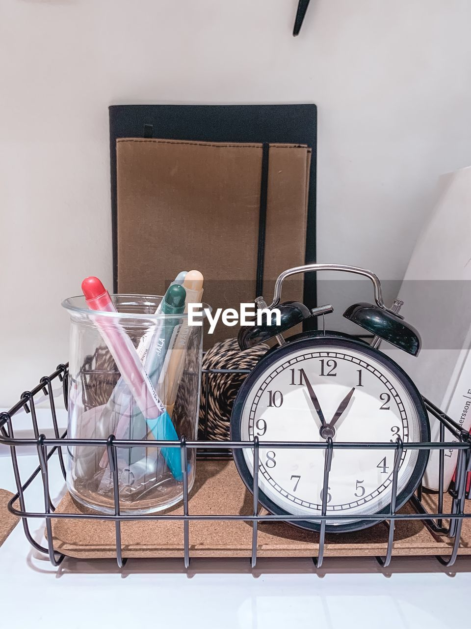 indoors, no people, still life, alarm clock, time, clock, container, table, accuracy, wall - building feature, representation, wood - material, glass - material, close-up, home interior, number, animal representation, group of objects, publication