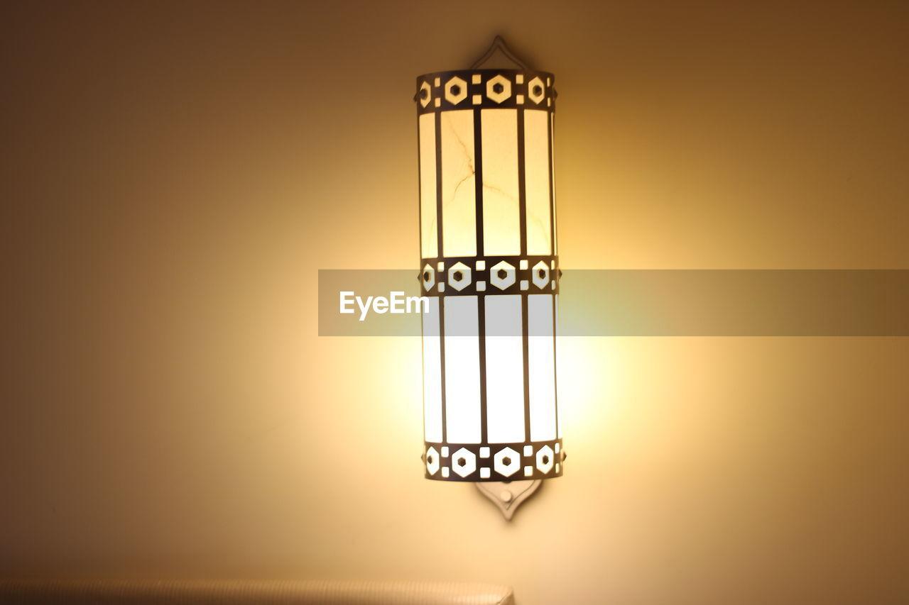 Illuminated electric lamp mounted on wall