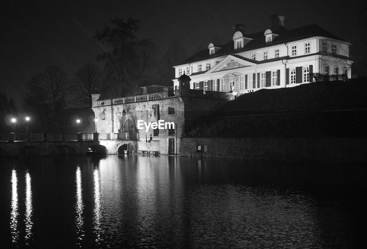 architecture, building exterior, built structure, night, illuminated, water, river, waterfront, outdoors, no people, sky, tree, city