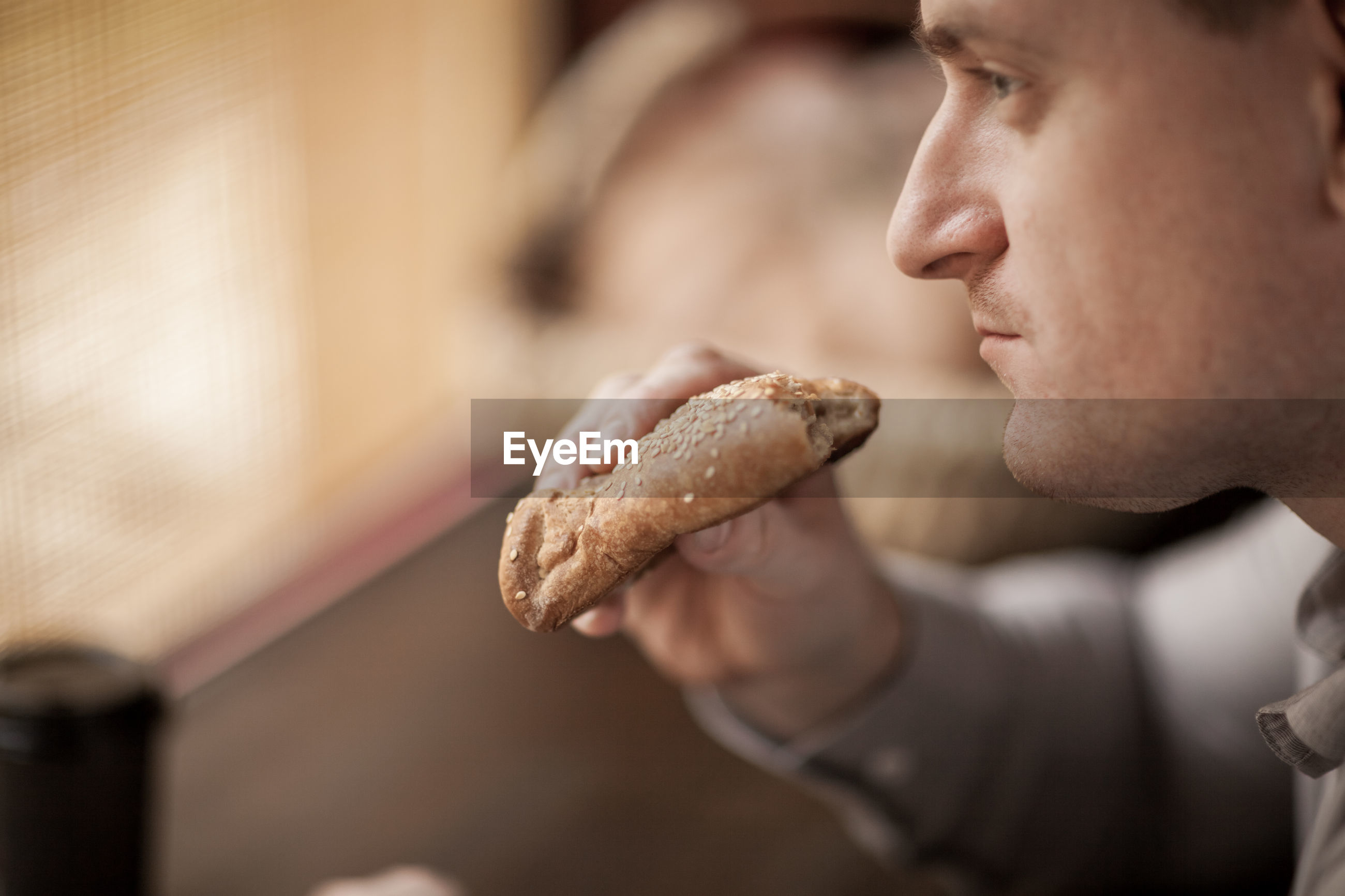 Man eating bread in cafe