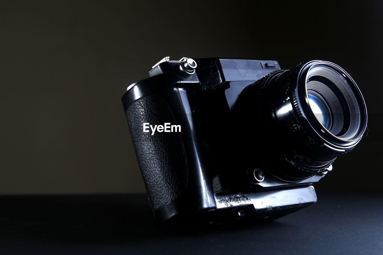Close-Up Of Camera On Black Background