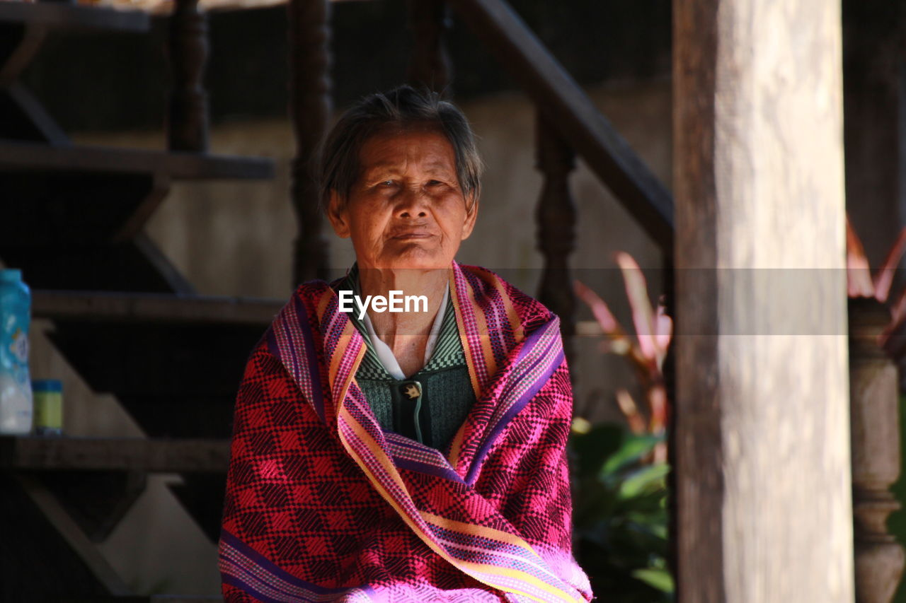 Portrait Of Senior Woman Against Staircase
