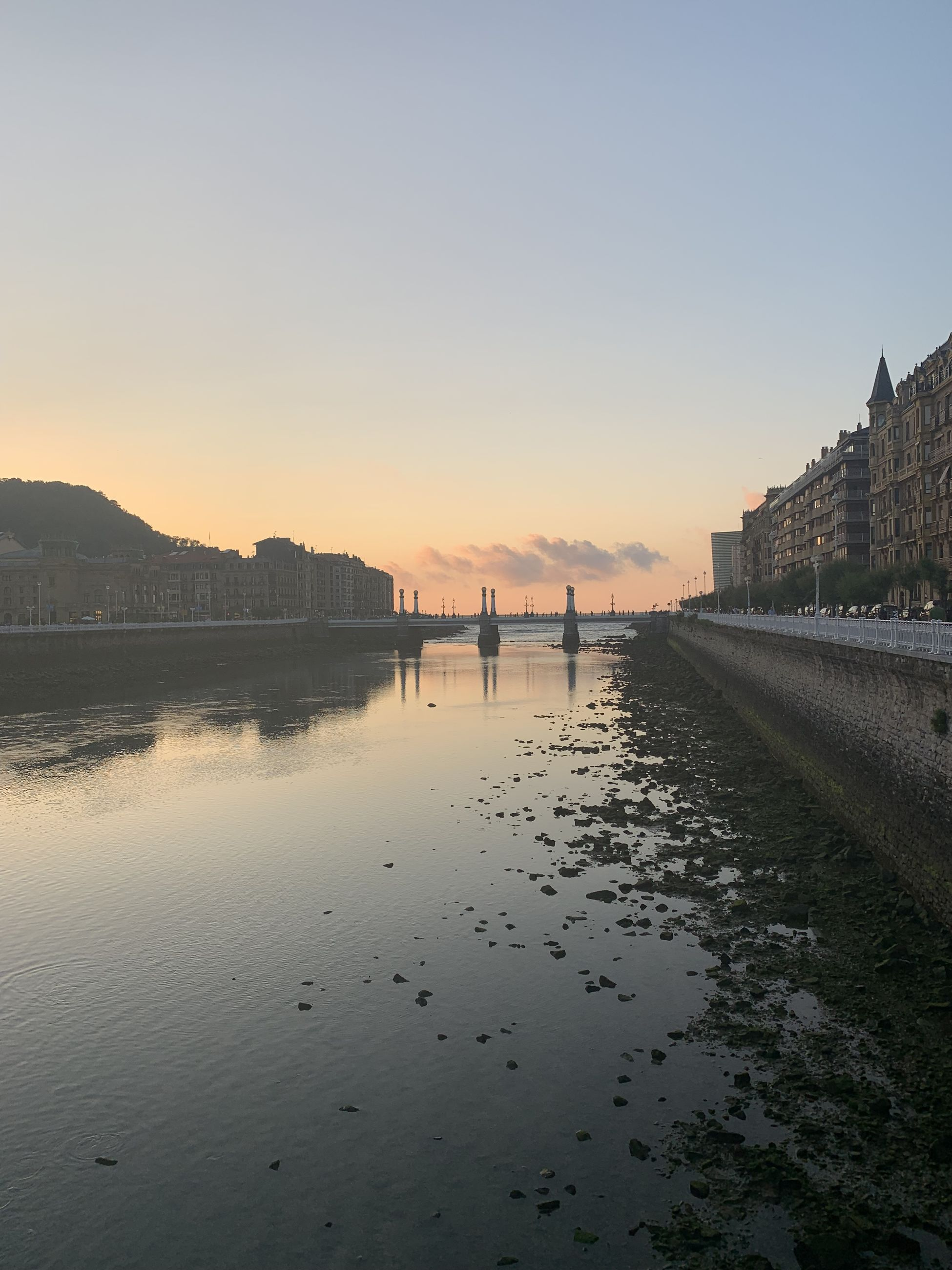 Scenic view of river against clear sky during sunset