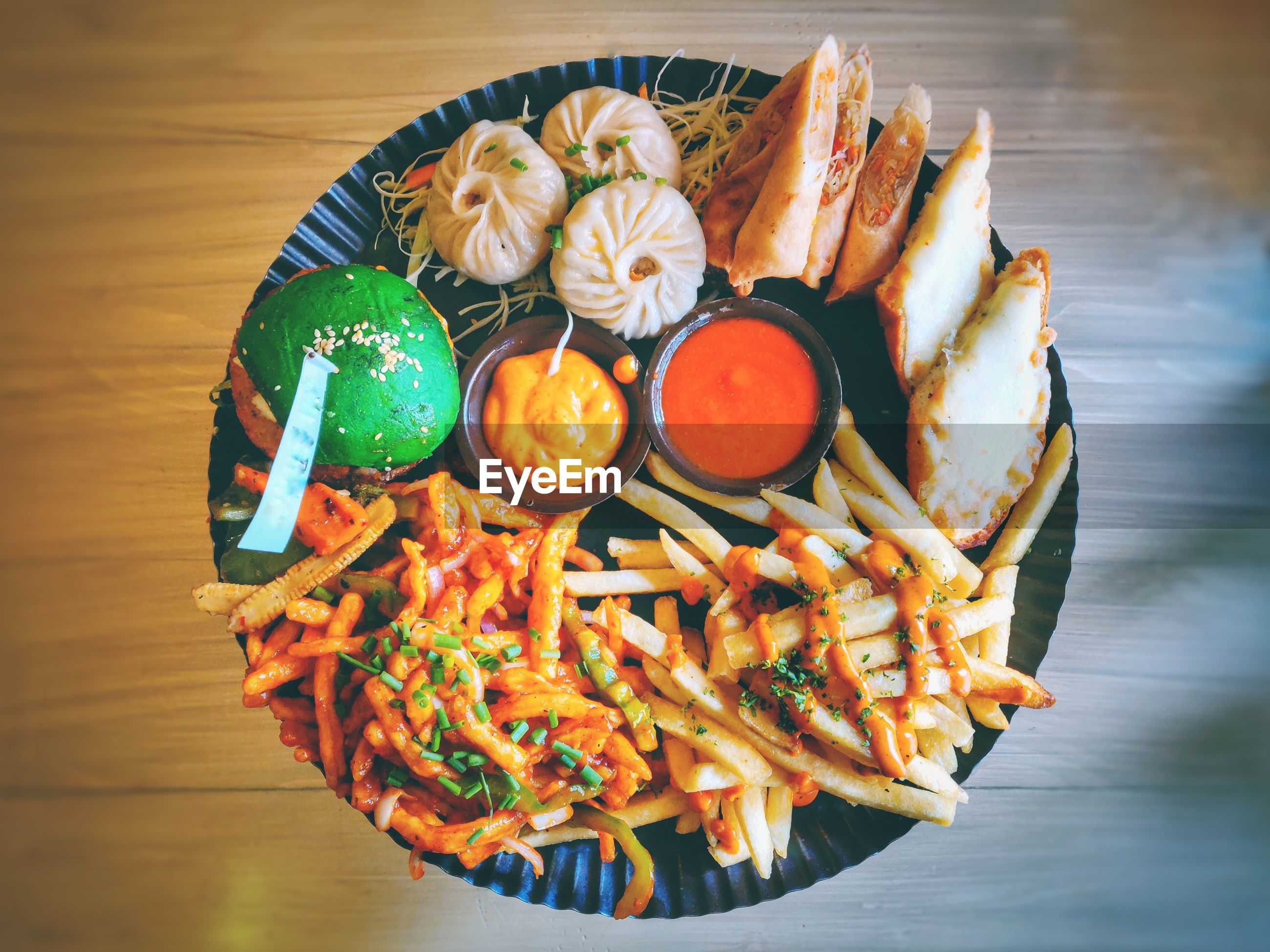 HIGH ANGLE VIEW OF MULTI COLORED FOOD ON TABLE