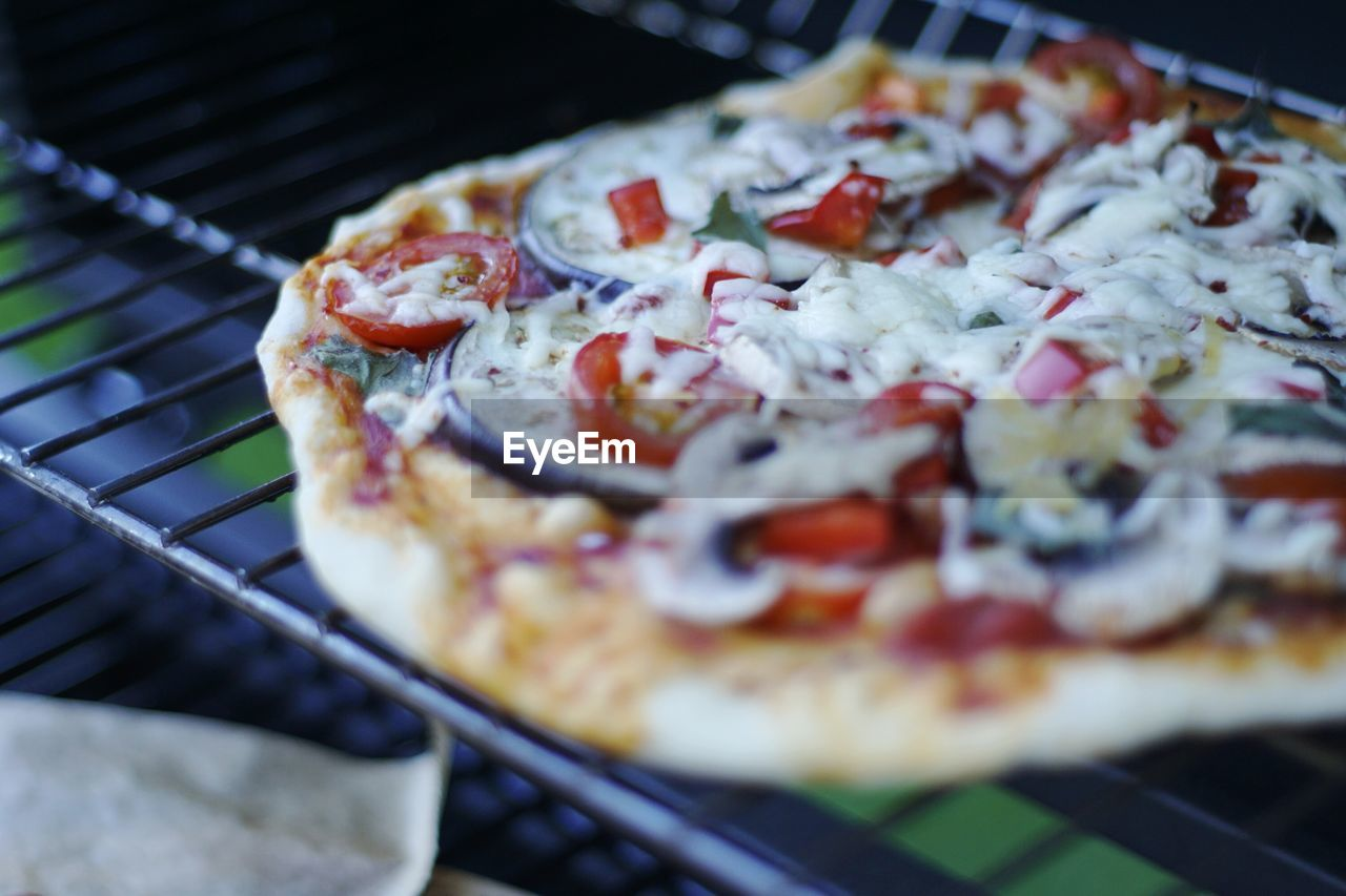 Close-up of pizza on cooling rack