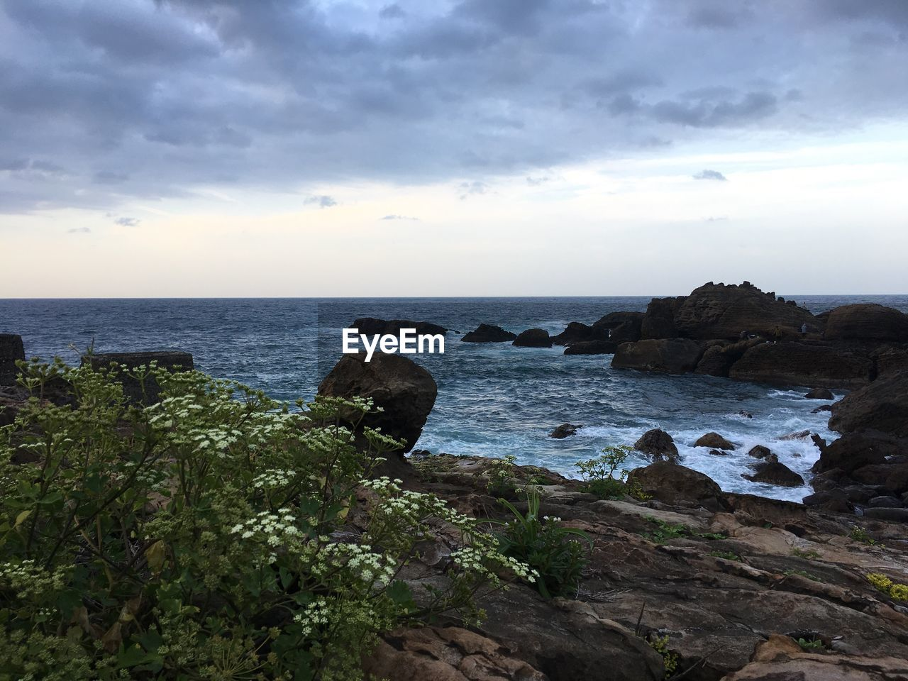 sky, sea, water, scenics - nature, beauty in nature, cloud - sky, horizon, horizon over water, rock, tranquil scene, land, tranquility, rock - object, solid, beach, nature, no people, non-urban scene, rock formation, outdoors, rocky coastline