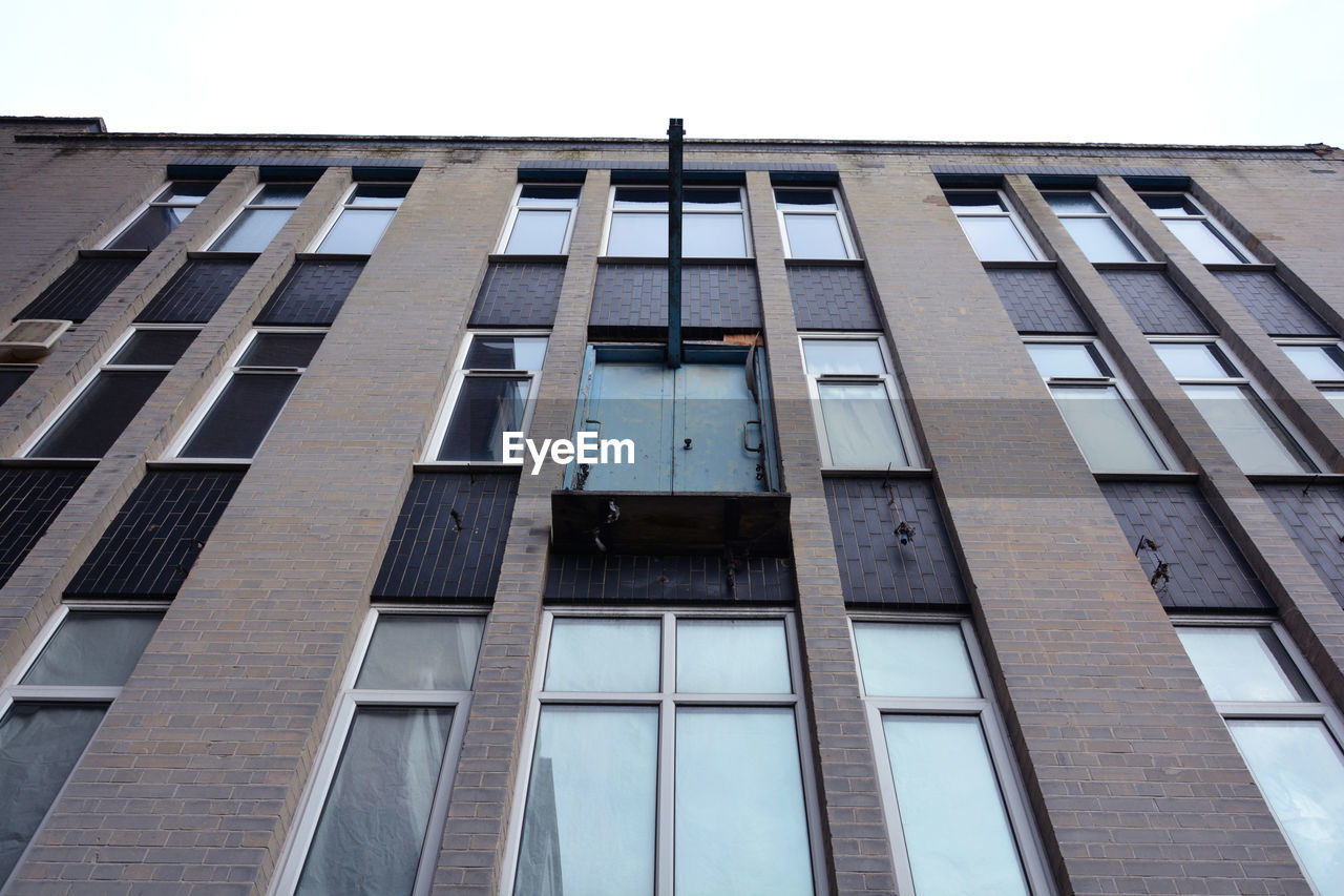 architecture, building exterior, window, built structure, low angle view, architectural style, outdoors, day, no people, sky