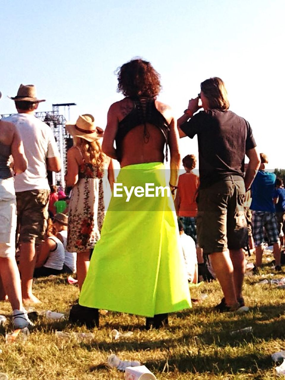 rear view, full length, leisure activity, real people, casual clothing, lifestyles, women, celebration, men, large group of people, togetherness, enjoyment, outdoors, day, life events, clear sky, standing, grass, sky, bride, adult, people, adults only