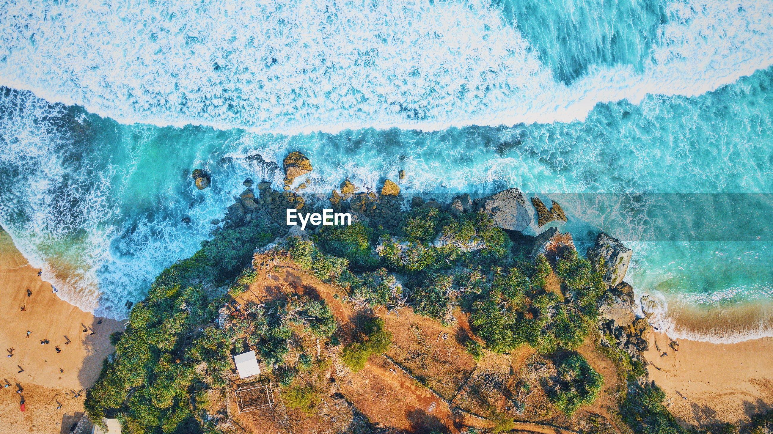 Aerial view of rocks at beach